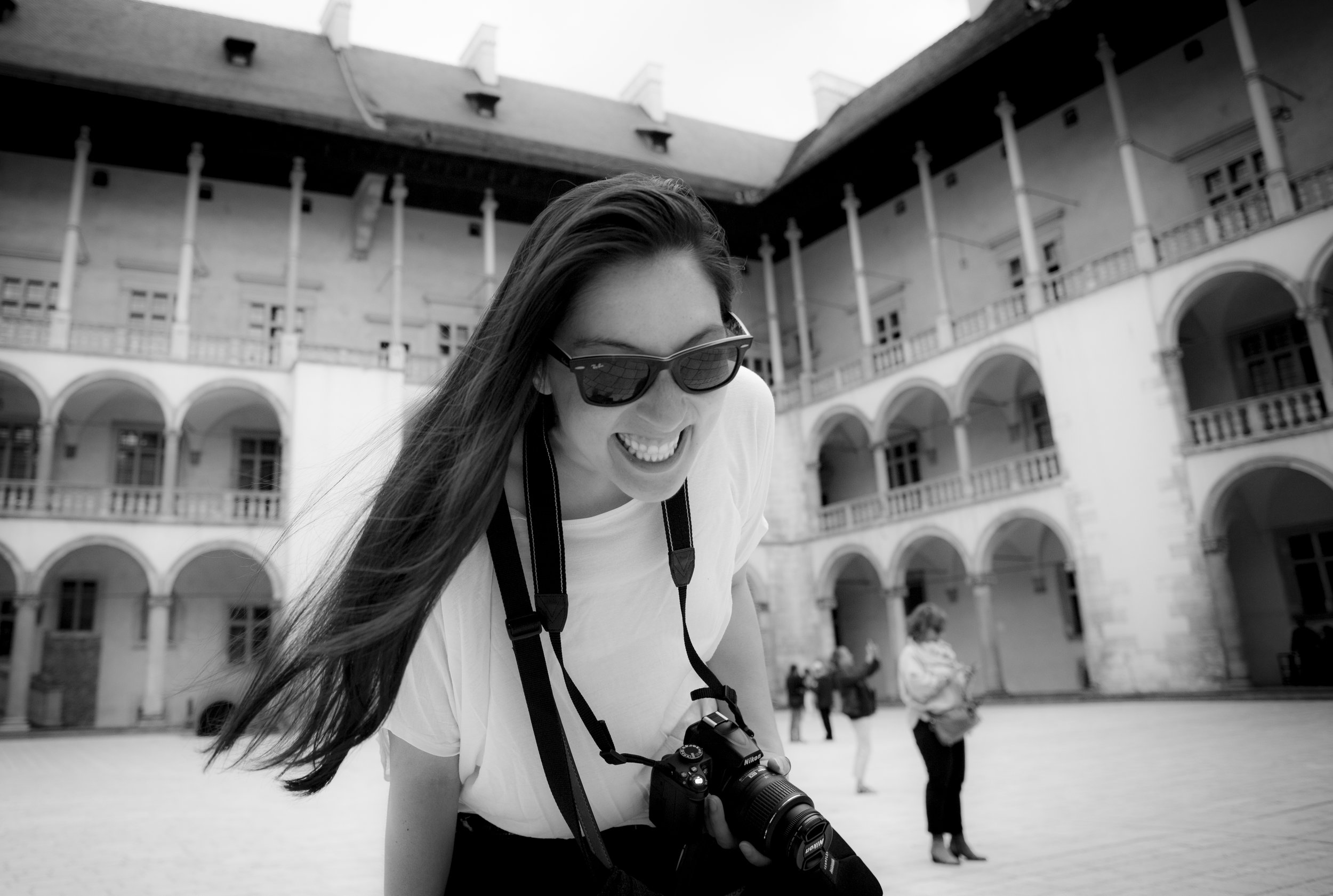 Stephanie with her camera while travelling in Krakow, Poland.
