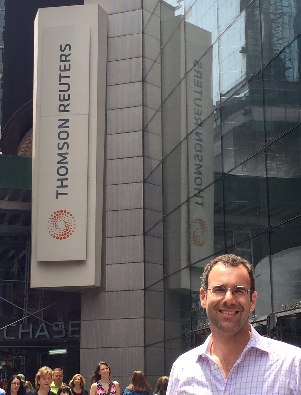 Neil standing in front of the Times Squares location of Thomson Reuters
