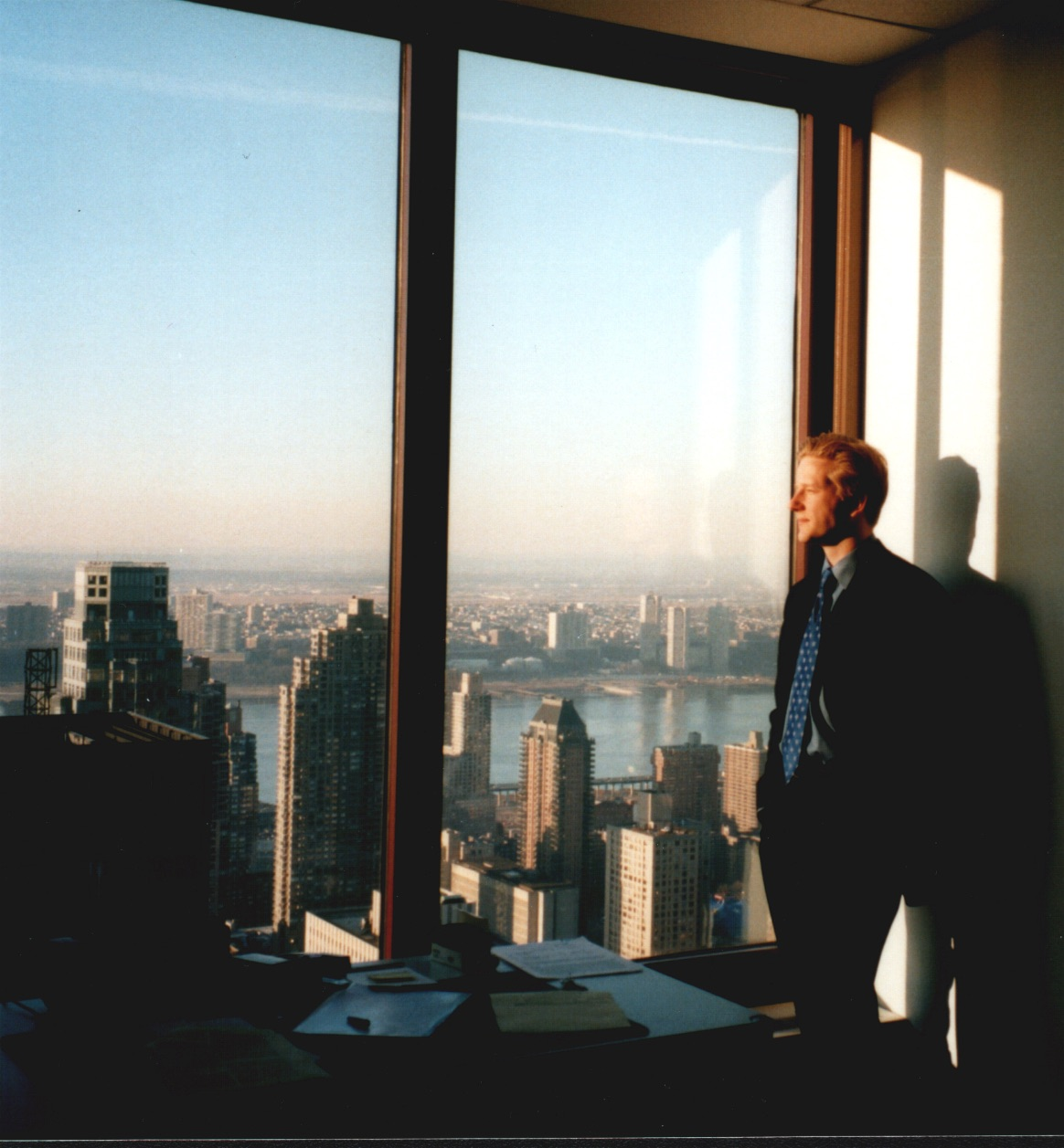 Close to my desk – taken in Manhattan, Carnegie Hall Tower, interning for a large firm, a long long time ago. There were no smart phones, not even digital cameras; one of my fellow interns must have brought a camera for some reason and caught me staring into the sunset instead of at my files.