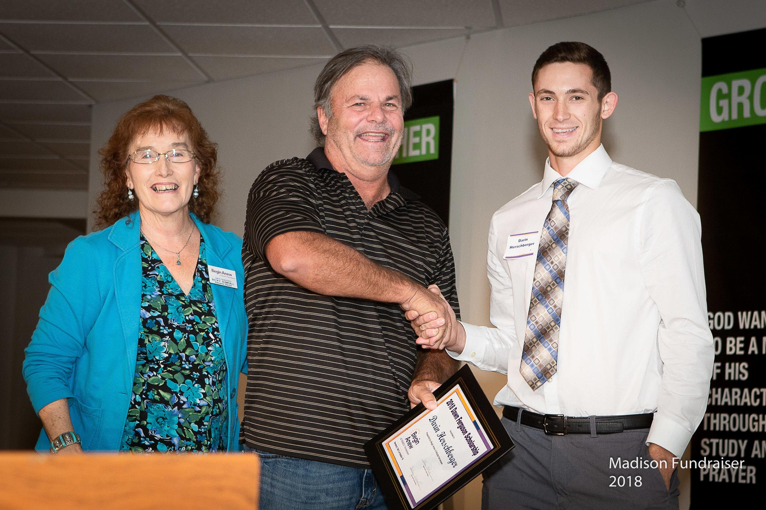 Becky Sumrall and Chuck Kemp present the Dawn Ferguson Scholarship to Darin Herschberger