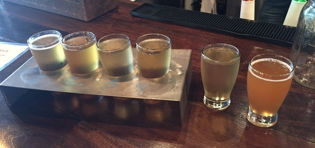 A flight of craft ciders from Urban Tree Cidery in Atlanta. Urban Tree is one of a crop of artisan craft cideries edging their way into the mainstream marketplace.