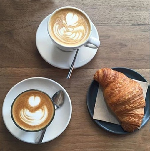 Latte? Flat white? Cappuccino? Whatever you wish, we will whip. And don't forget the homemade croissant. • • • #foodie #coffeeshop #nyccoffee #eatingfortheinsta #hamiltonheights #harlemnyc #croissant #neighborhood #nyceats #icedcappuccino #chill