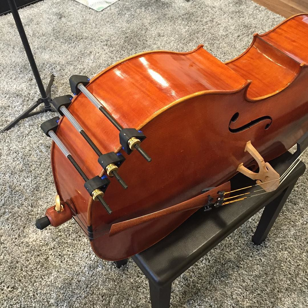 "A quick little seam repair on my cello this morning. It opened up the other night while I was teaching with a sudden ""crack"" sound!    #hothideglue #cello #repair #luthier #kelvinscott #herdim #clamps #quickfix #hideglue  http://ift.tt/1PHbuPw"