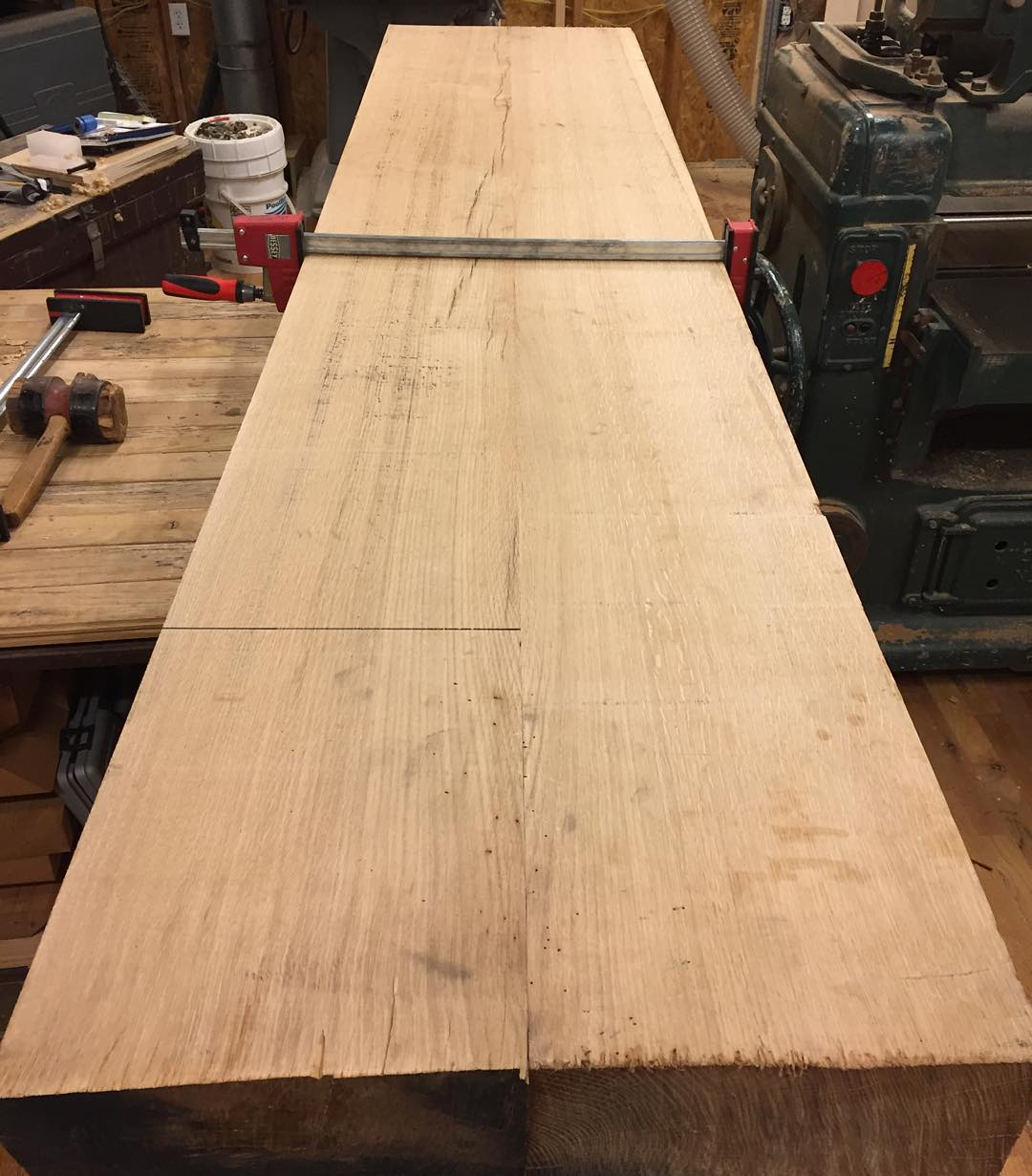 """Ok here are the two white oak slabs for the top of my new Roubo workbench. I did the heavy lifting with my 16"""" Northfield jointer and my 24"""" Oliver 299 planer. The final flattening of the centerline joint was done with my #lienielsen #7 plane. It has a slight hollow along the 110"""" length. The last 5"""" on each end will eventually be cut off to give the finished length.  #workbench #roubo #workshop #woodwork #woodworking #wood #whiteoak #jointer #handmade #handtools  #madeinusa #madeinmichigan #shop  http://ift.tt/1R695mZ"""