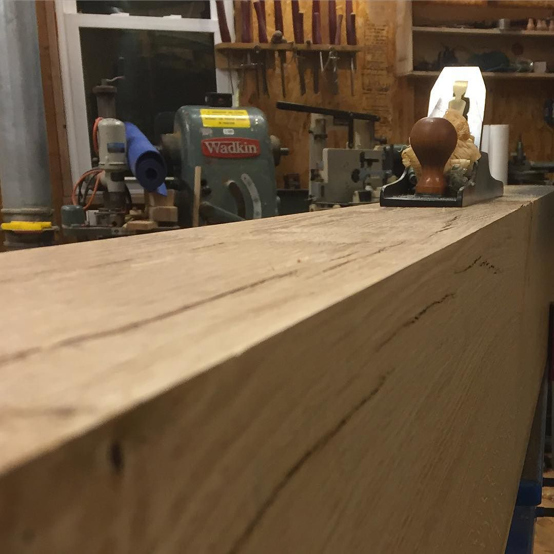 """Using my #lienielsen jointer plane to create a super tight glue joint seam for my workbench top. These 6""""x12"""" white oak beams for my new workbench weigh about 200lbs each. I used my 16"""" Northfield jointer to flatten a face and square up and edge. That being said, it was difficult to keep a consistent feed rate because of the mass and weight. This left a less-than-perfect surface for the center glue joint. I almost always follow up machine work with hand tools for the final finish.  #workbench #roubo #workshop #woodwork #woodworking #wood #whiteoak #jointer #handmade #handtools  #madeinusa #madeinmichigan #shop  http://ift.tt/1OJeUFm"""