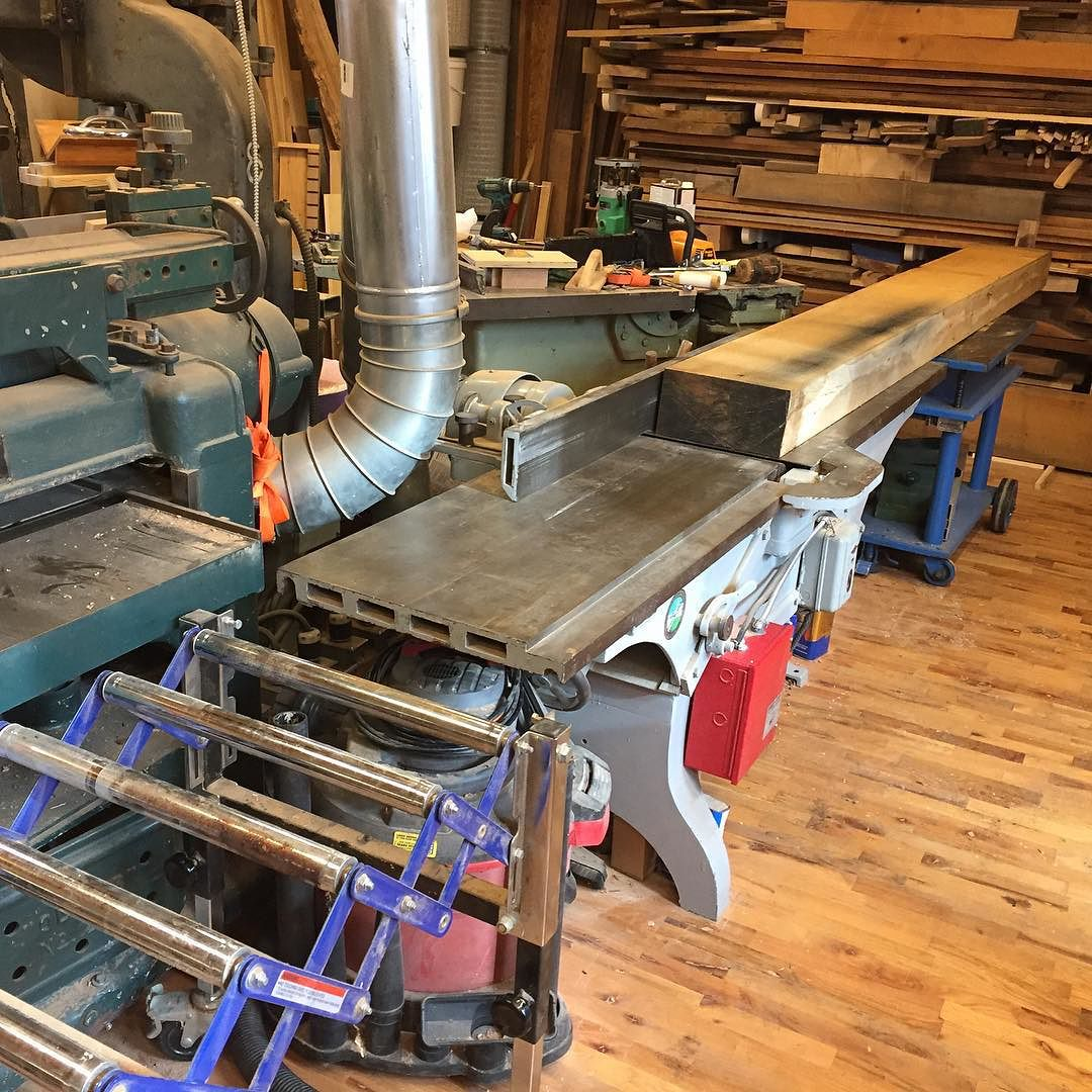 """With my new intern Walter I started facing the giant 10ft 6""""x12"""" white oak slabs for my new workbench. Due to space constraints, the bench will need to eventually be cut down to 103"""" including the endcap. The left hand end will also receive a turtleback Emmert vise and that will unfortunately eat up about 8"""" worth of length. Oh well…  #condortails #madeinusa #madeinmichigan #Benchcrafted #woodshop #workshop  #woodwork  #handmade #workbench #roubo #tenon #dovetail #legvise #wagonwheel #woodworking #mcmfurniture #lienielsen #whiteoak  http://ift.tt/1IpAJIQ"""
