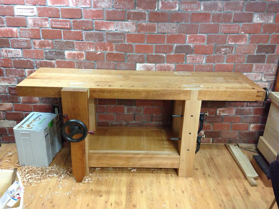 Quick shot of the new Roubo workbench with a coat of shellac on the shelf. Now I just need to finish the tool rack for the back and she's done. Better pics coming soon… #condortails #madeinusa #madeinmichigan #Benchcrafted #woodshop #workshop  #woodwork  #handmade #cherry #beech  #workbench #roubo #tenon #dovetail #legvise #wagonwheel #woodworking #mcmfurniture #lienielsen #whiteoak  http://ift.tt/1MFp2Jy