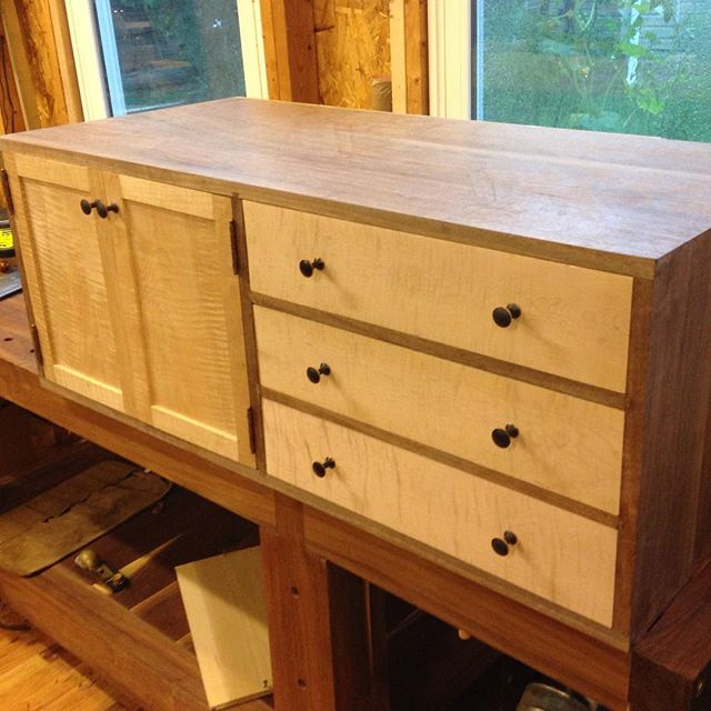 """Kelvin's cabinet is """"done"""" - although it seems like the final 5% of a project is what really takes time. I can find something I'd like to make a little better each time I look at it. Ugh…  #cabinet #maple #walnut #mcmfurniture #hinge #hardware #installation #design #handmade #madeinusa #madeinmichigan #kelvinscabinet #doors #butthinge #workshop #woodworking  http://ift.tt/1JR9zom"""