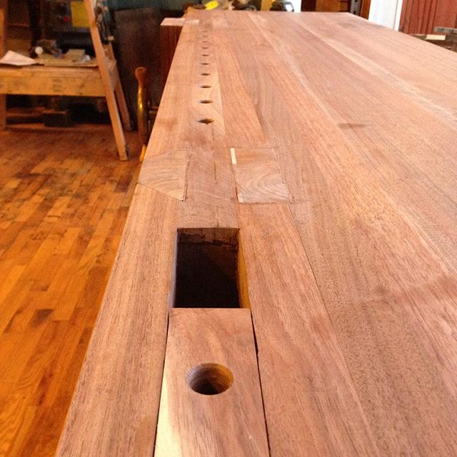 """David's @cupandchisel workbench is coming along nicely. I drilled the holes along the front edge of the top today. 10 holes at 4"""" on center.  #walnut #workbench #bench #Benchcrafted #woodporn #holdfast #dogholes #cupandchisel  http://ift.tt/1LvsNWH"""