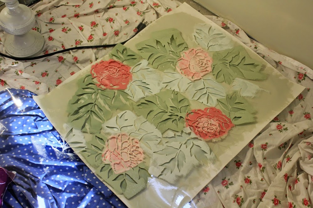 Very quickly I began to get mixed-up when I tried to match the peony pattern on the wall. If you are stenciling with multiple colors, make a template on an old piece or cardboard or poster board so that you can refer to it during the process.