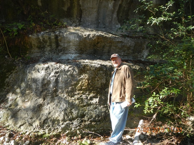 Trip leader, Al Cherepon, at an exposure of the Walnut Formation near Hearth/Great Hills Spring.