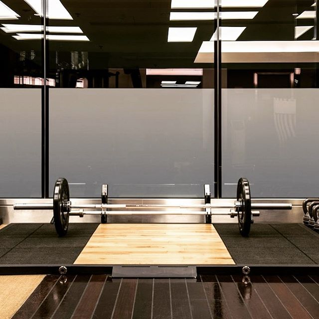 More hotel gyms need a setup like this.  The Mandarin Oriental Hyde Park, London's fitness center includes an Olympic weightlifting platform with barbells and kettlebells.