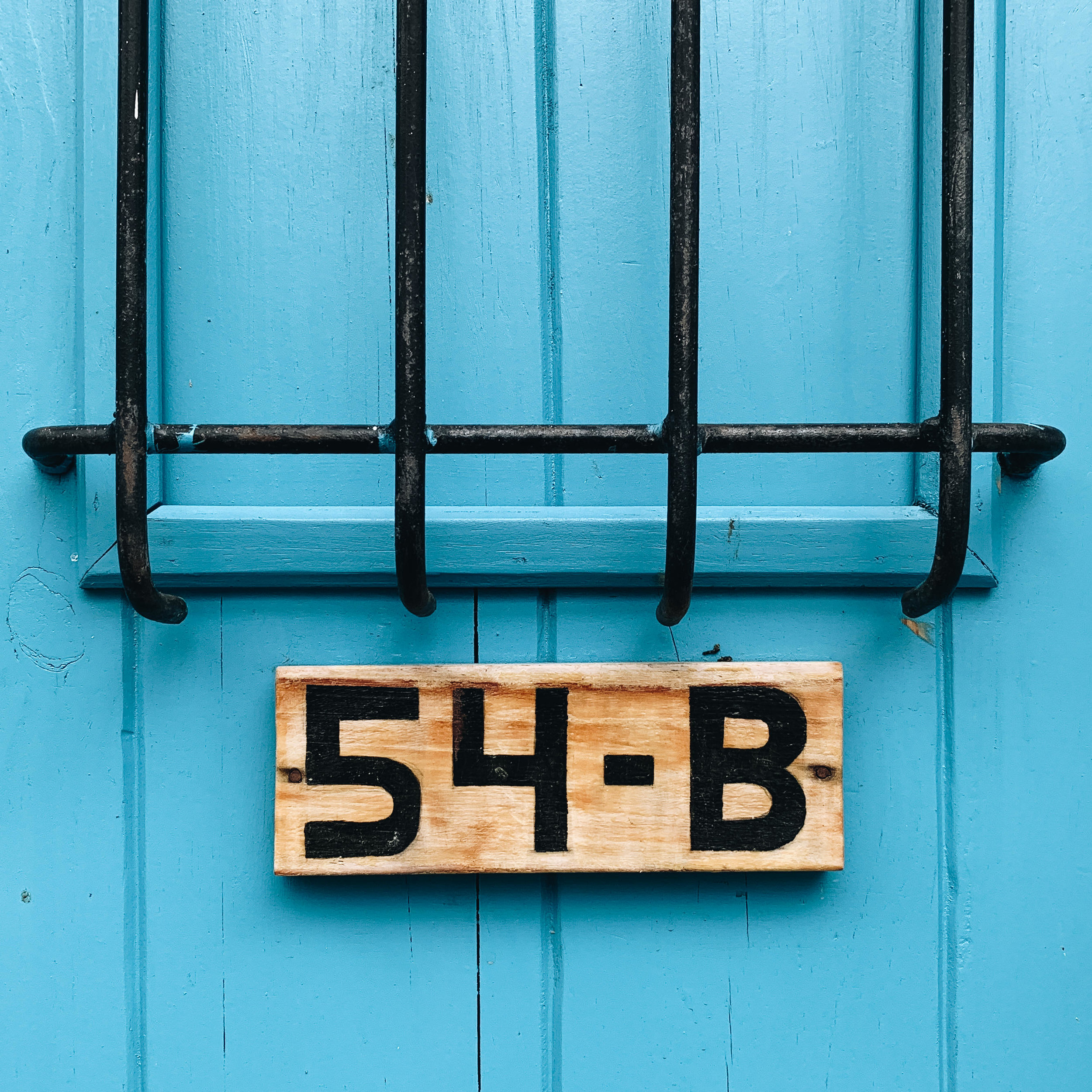 Details of a colorful blue door in Zona Colonial, Dominican Republic