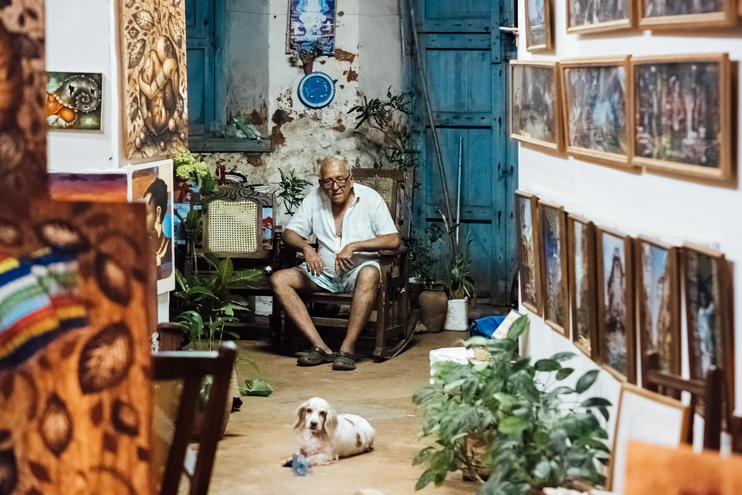 A beautiful story of an artist and his dog companion, photographed in his living space during a late night walk.