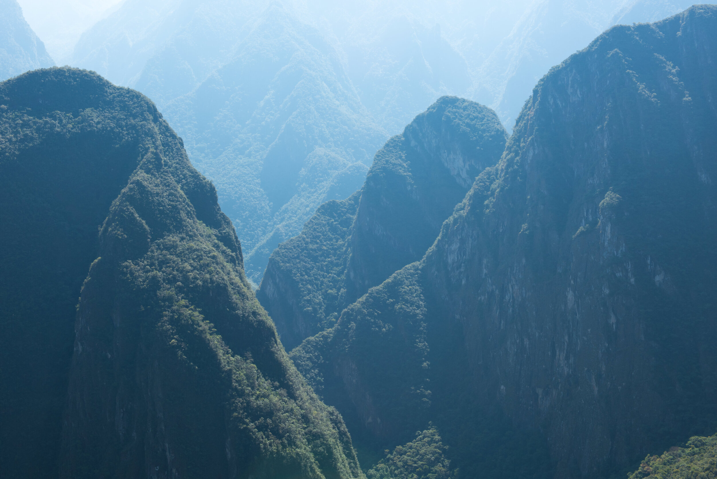 Hazy sunrise through the Andes Mountains that surround the Machu Picchu Incan Citadel.
