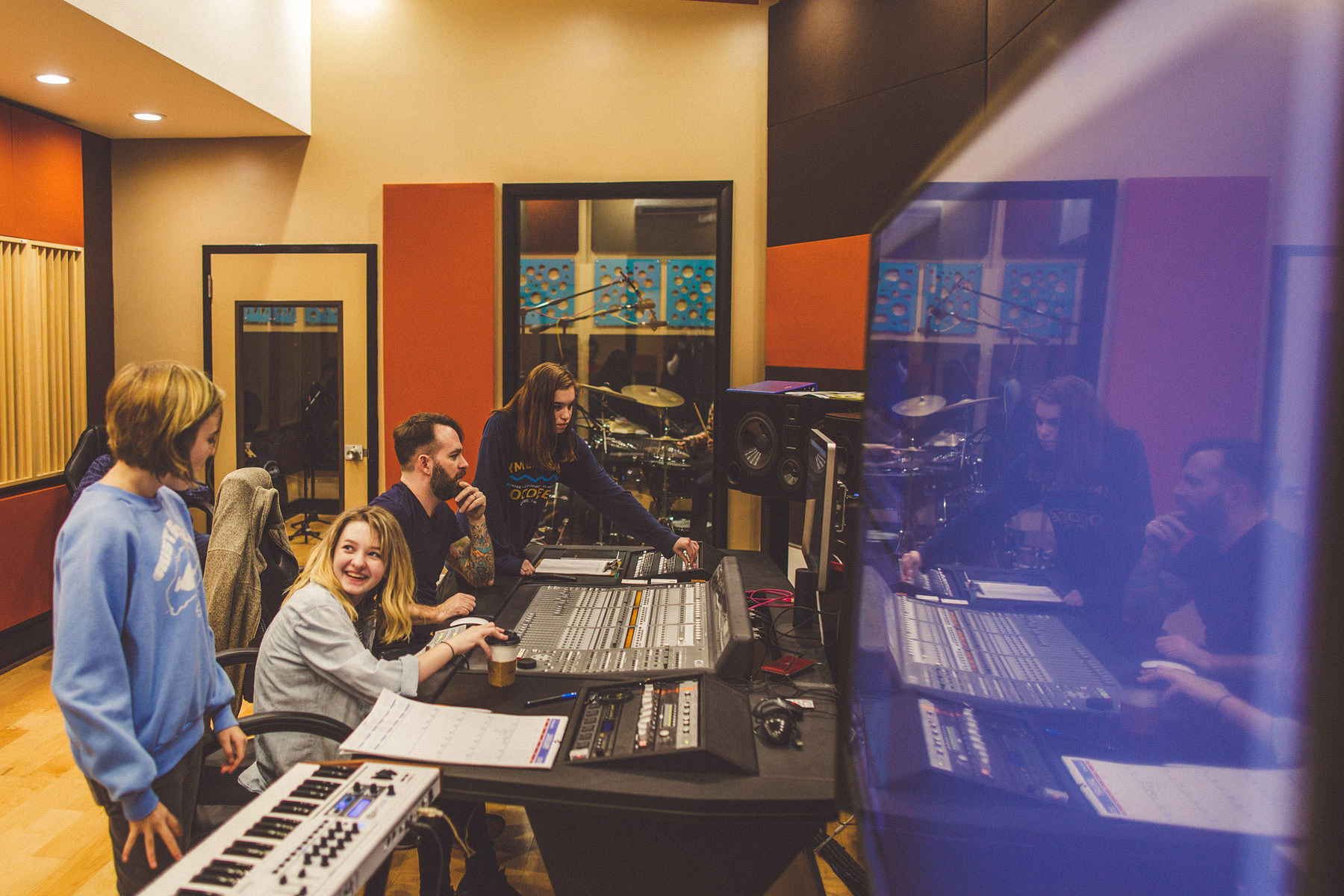 Students learning to mix with highly accredited music producer and audio engineer Tyler Orr.