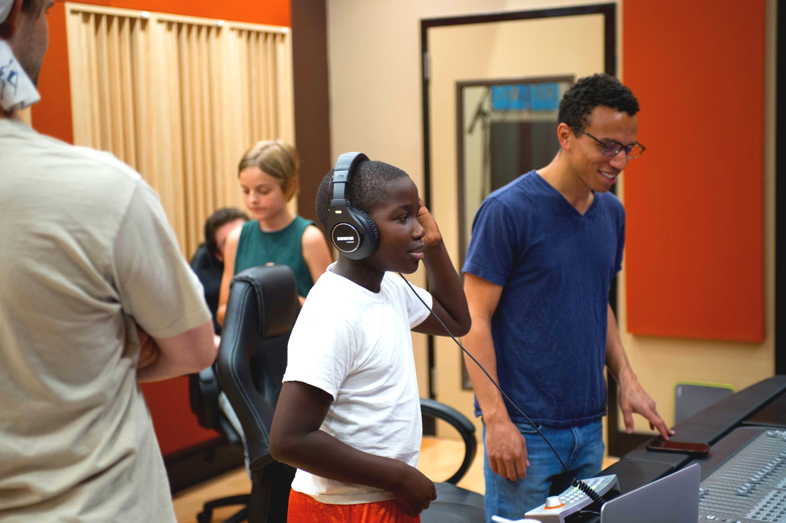Local students working with platinum record selling and Grammy nominated producer    Roark Bailey    and members of the Flock team.