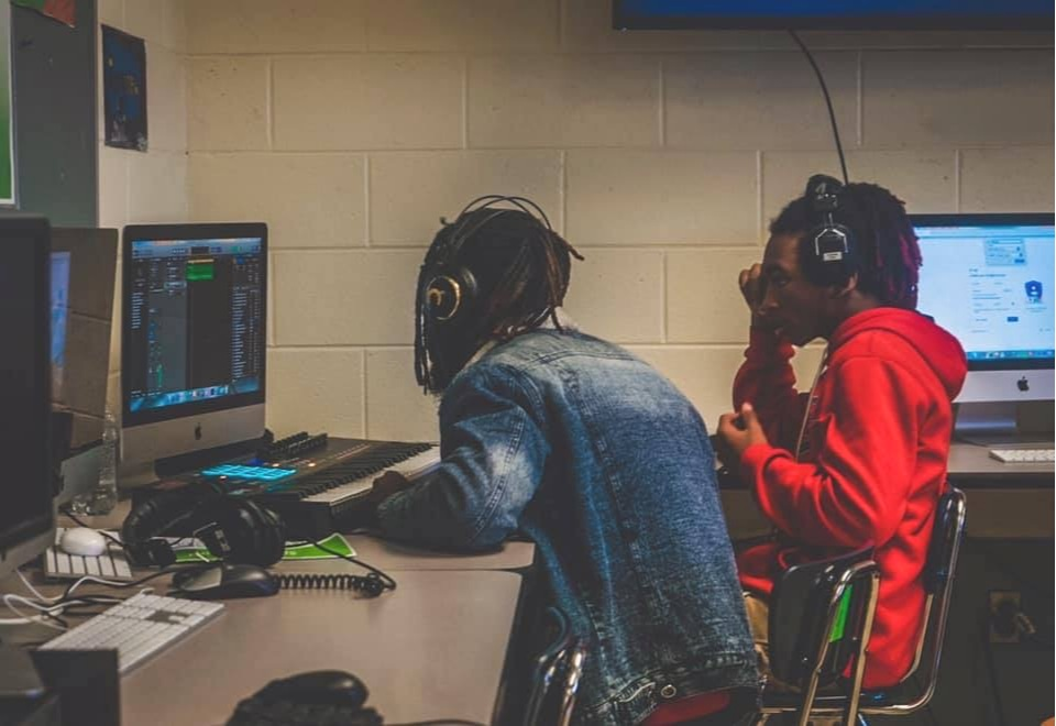An East Lake student working with Swayyvo to produce music for his record label PBL.
