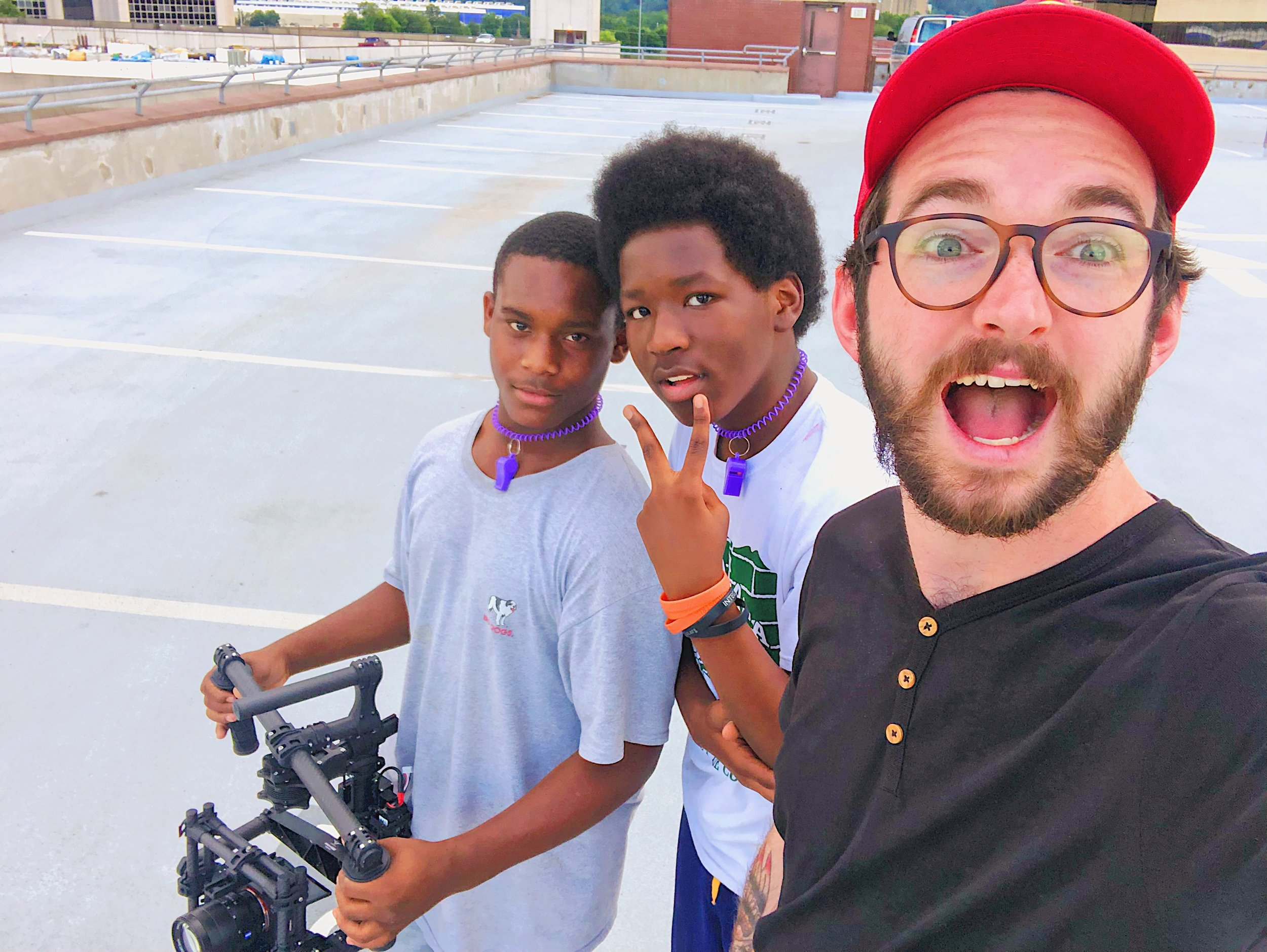 Local East Lake students shooting a music video on top of the EPB building.