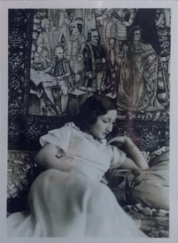 Amiryani's grandmother, Touri, with the Mashaheer carpet in 1934.