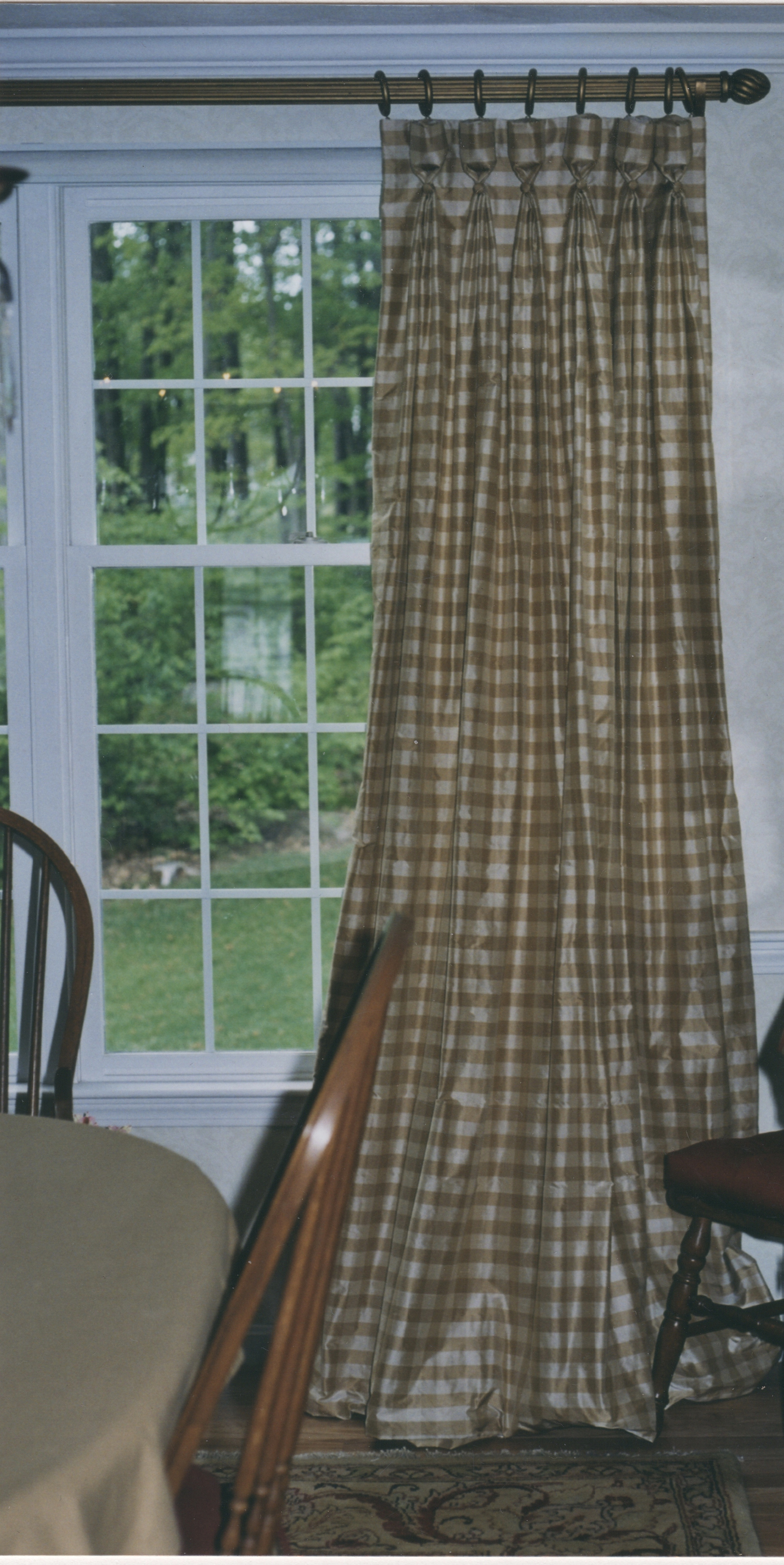 Casual Elegance is certainly stated with this gold checked silk. Silk catches the light and catches our attention. Silk frames the view for this family.