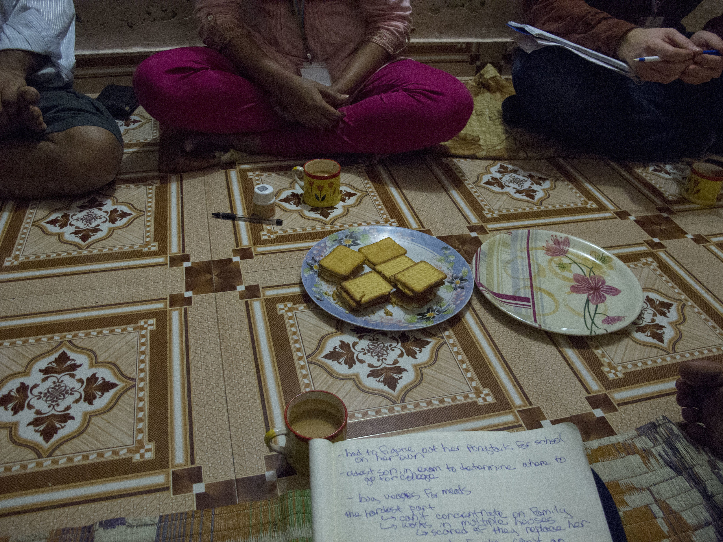 Chai and biscuits during an in-home interview.