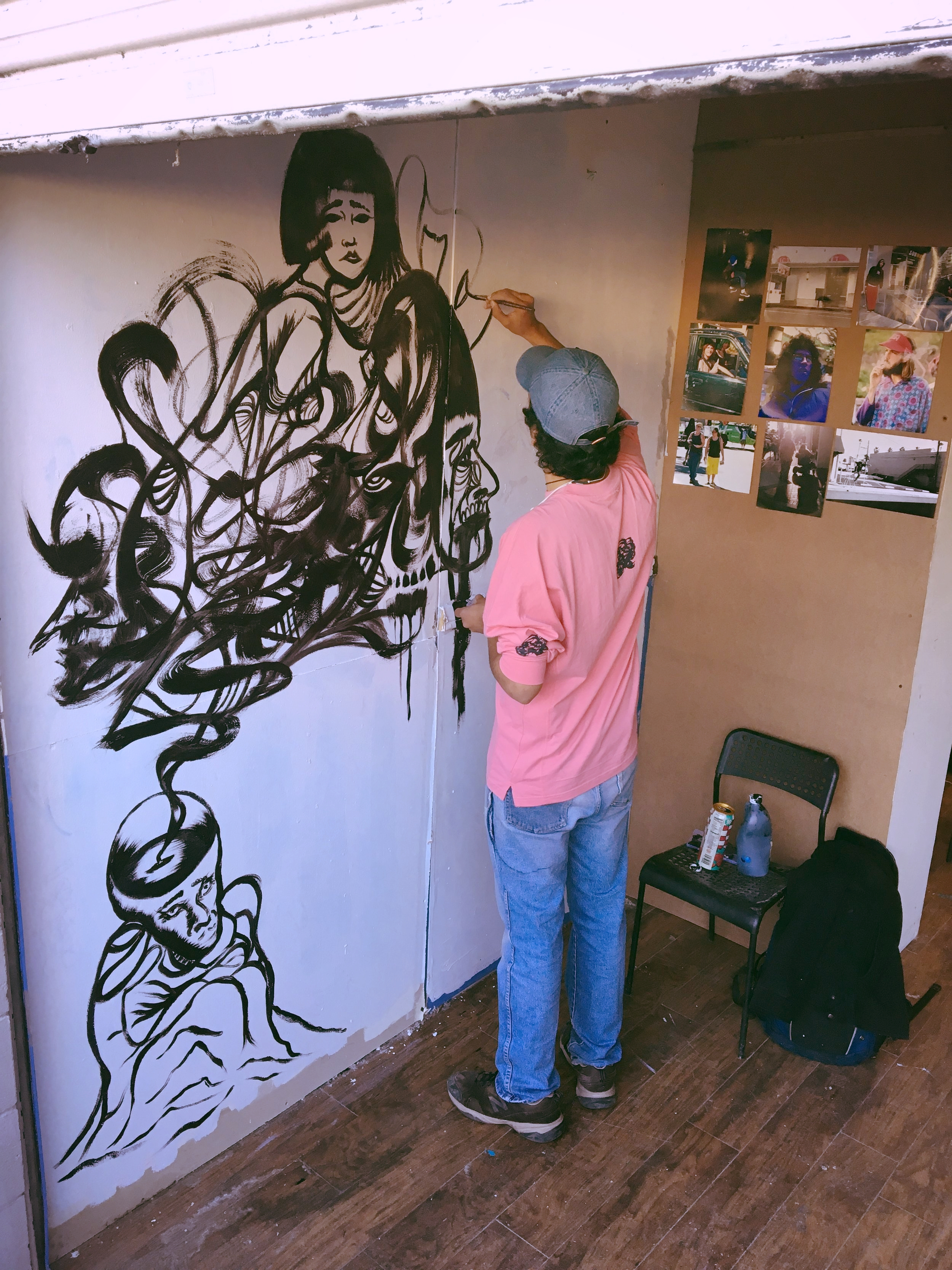 flowing at the KEITA warehouse / studio for art show 1.2017         the BEFORE pic                photographs on wall by Corey V.