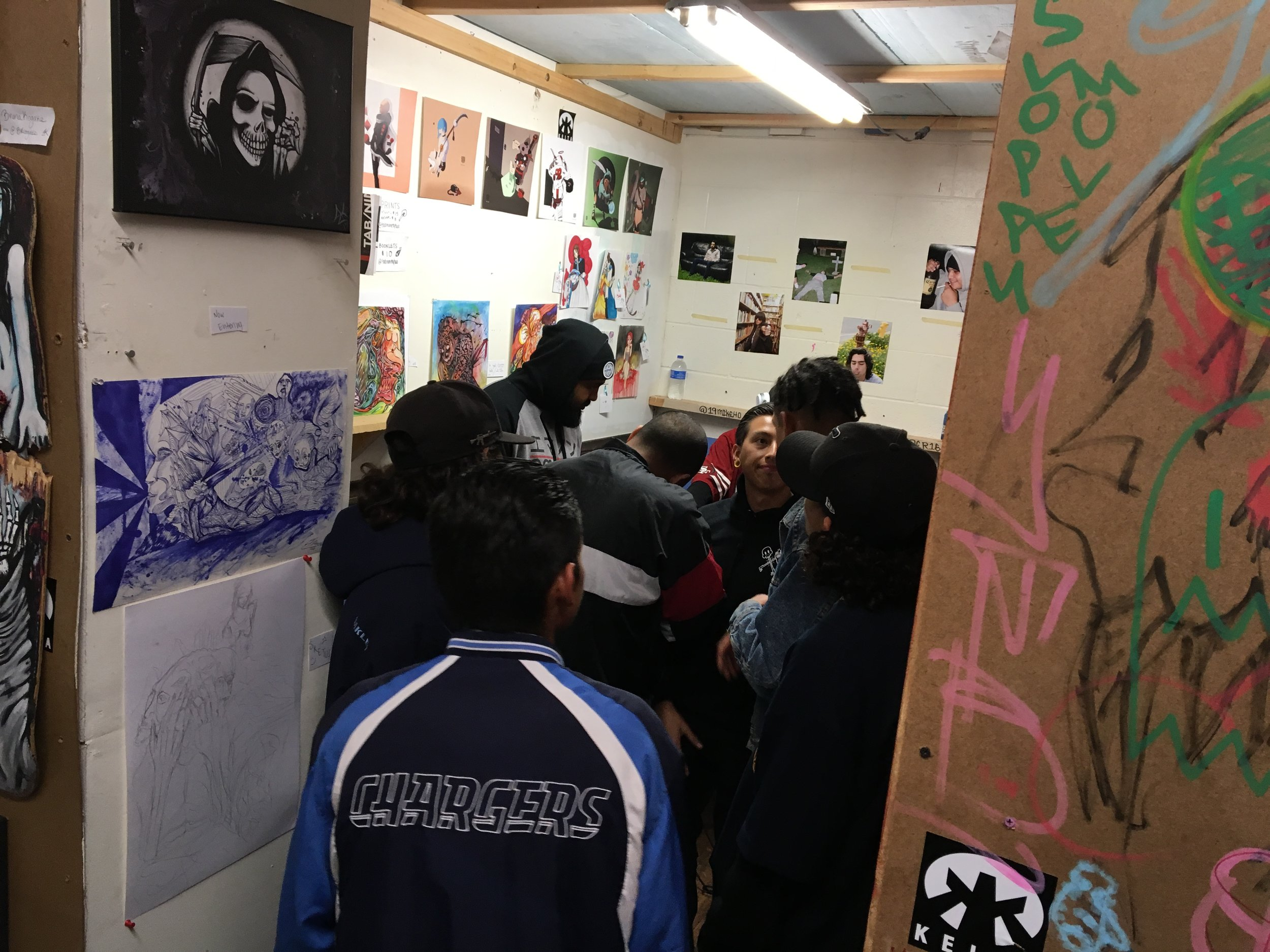 Tratyn of Tab92 showing. Gabe of EMANON representing Oceanside artists.