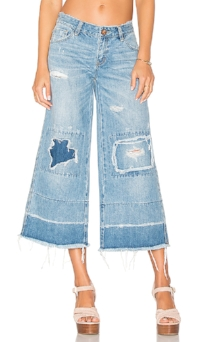 Lower body of a person wearing denim culottes