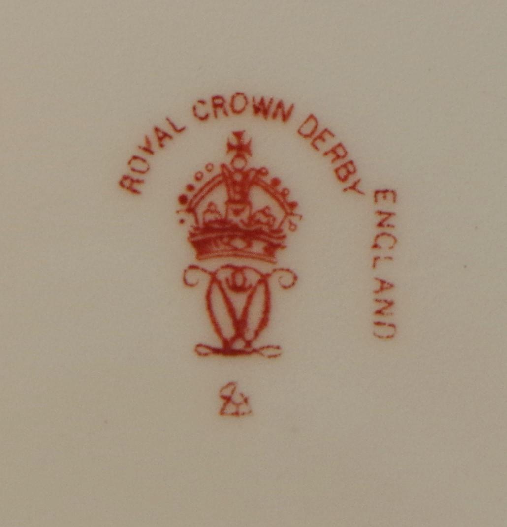 royal-crown-derby-clarence-shape-green-ground-to-rim-bird-centre-darlington-1921-mark