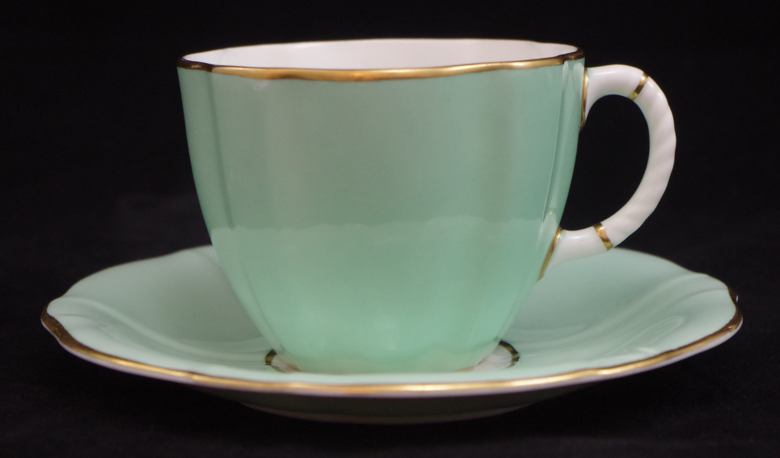 royal-crown-derby-surrey-shape-teacup-and saucer-celadon-ground