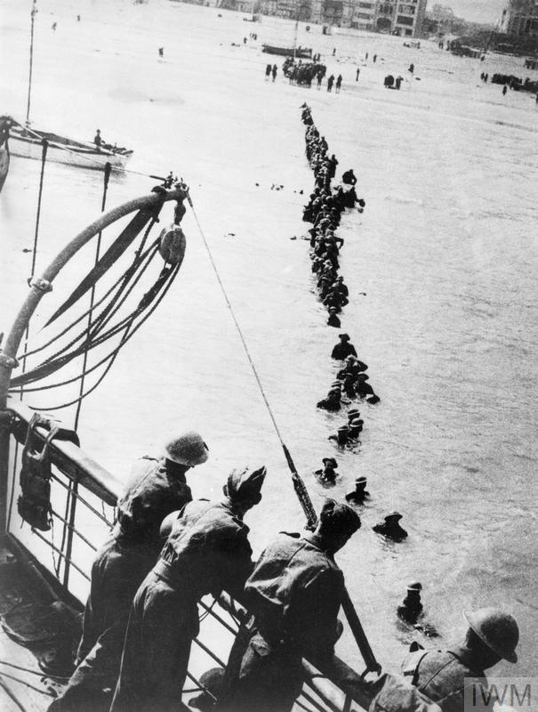 British soldiers wade out to a waiting destroyer off Dunkirk during Operation Dynamo. © IWM (HU 41240)