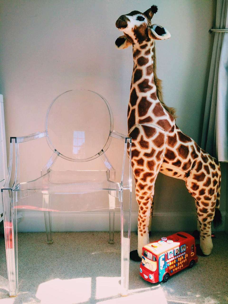 This is the Louis Ghost Chair by Kartell. And Geoffry the giraffe.