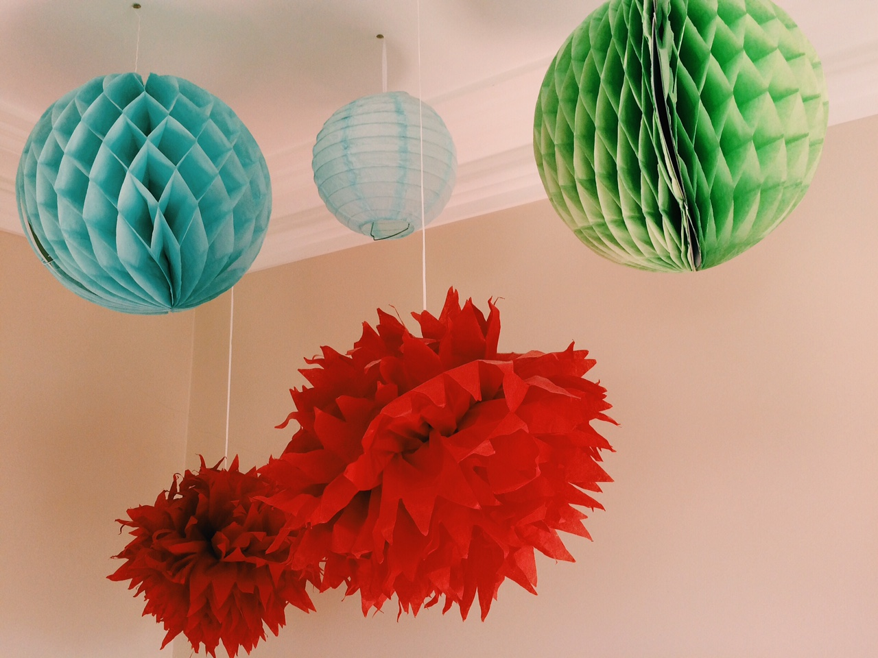 Pom Poms and lanterns by The Hanging Lantern Company.