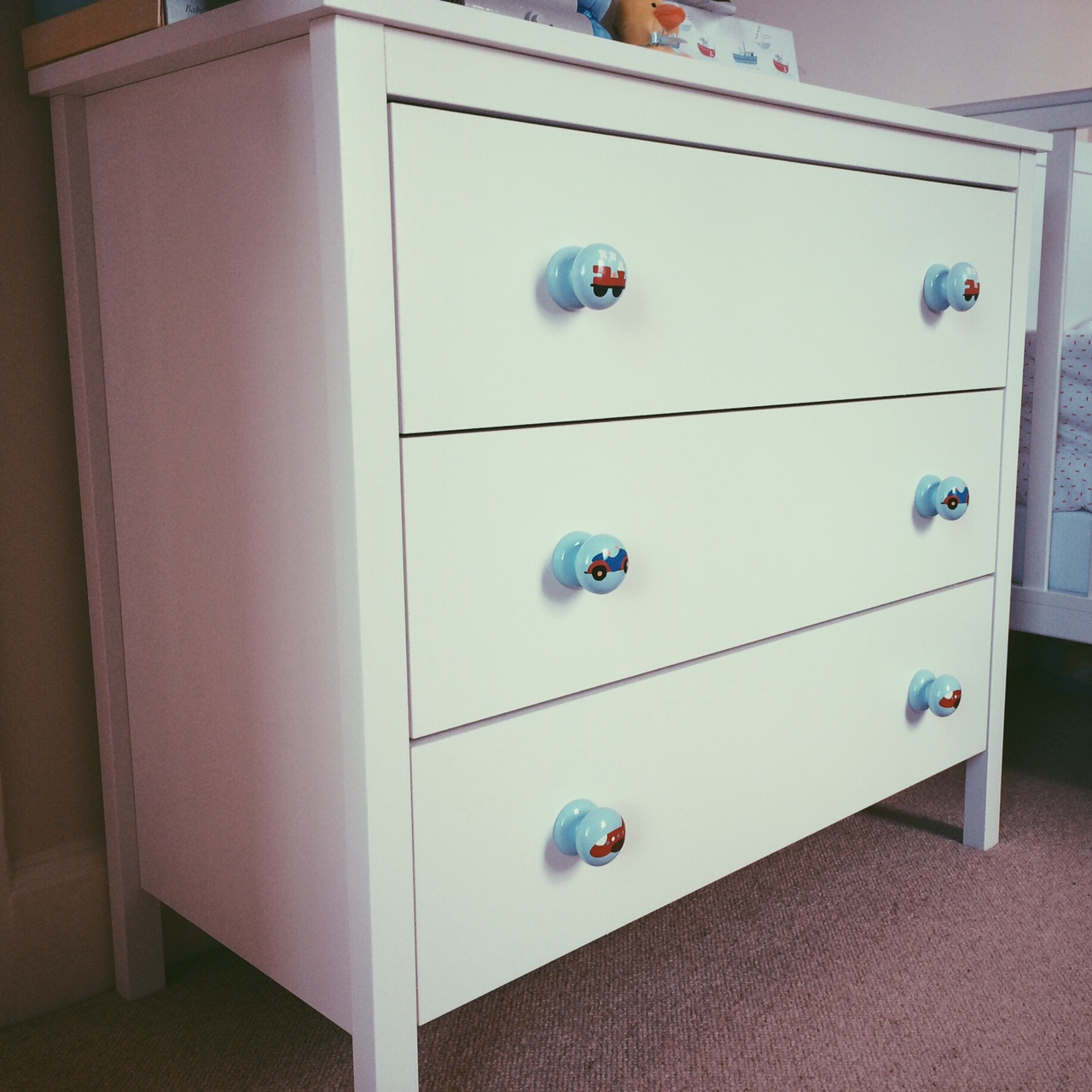 This is the Hensvik kids wardrobe and the Hemnes chest of drawers both by Ikea. The hand painted transport knobs were an Ebay purchase.