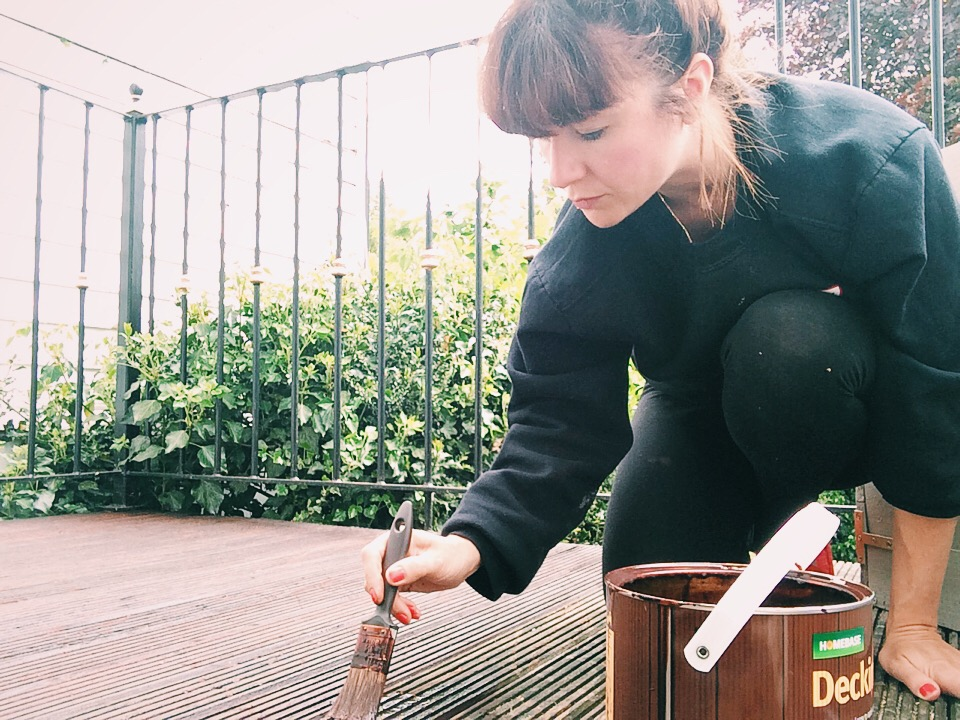Here's me painting the decking in Homebase Decking stain in Teak...