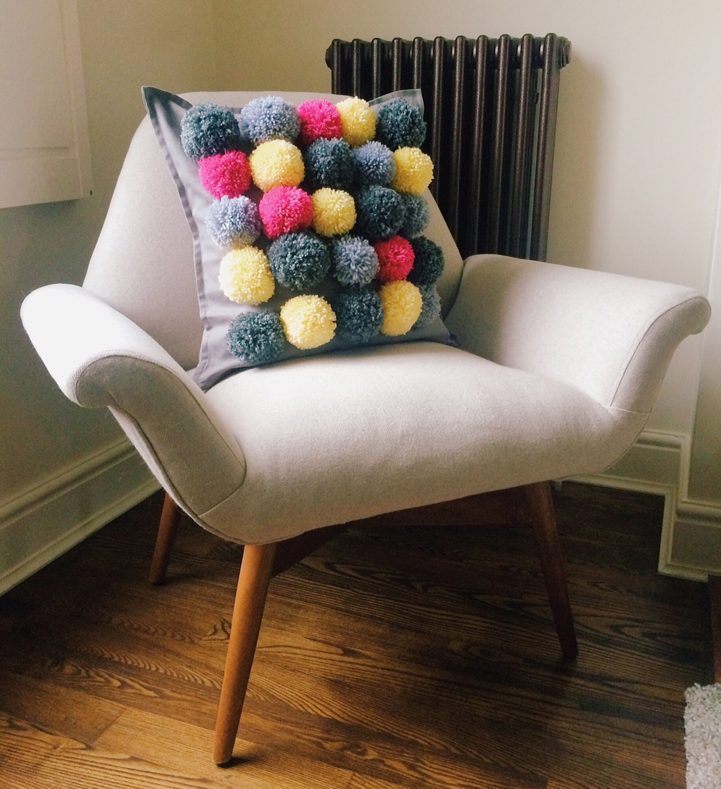 The end result of my crafted pom pom cushion! Arm chair by Swoon Editions.
