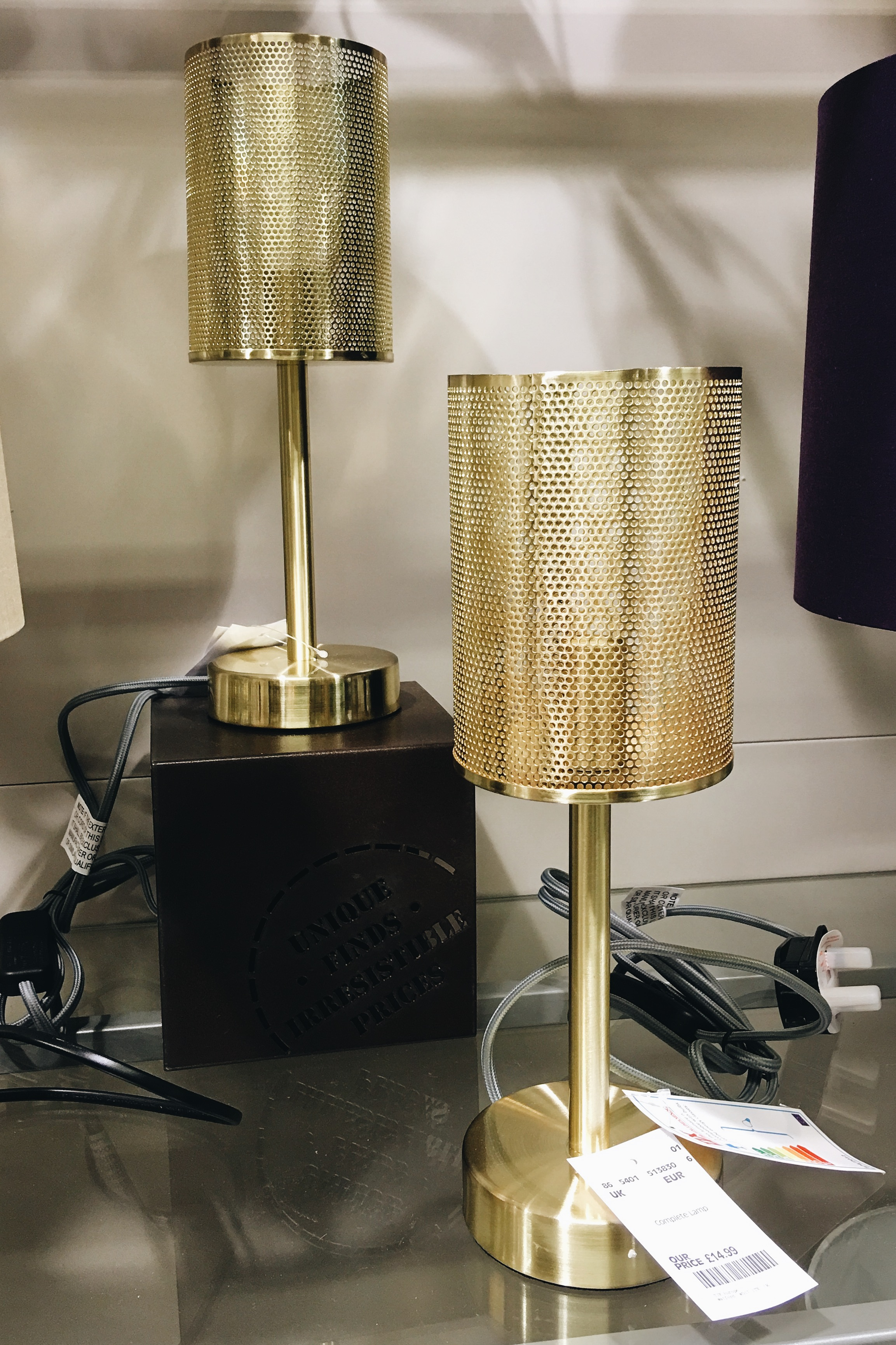 These gold lights are only £14.99 each. I'd buy two and have them as bedside table lamps - that's bedroom lighting sorted for just shy of only £30!