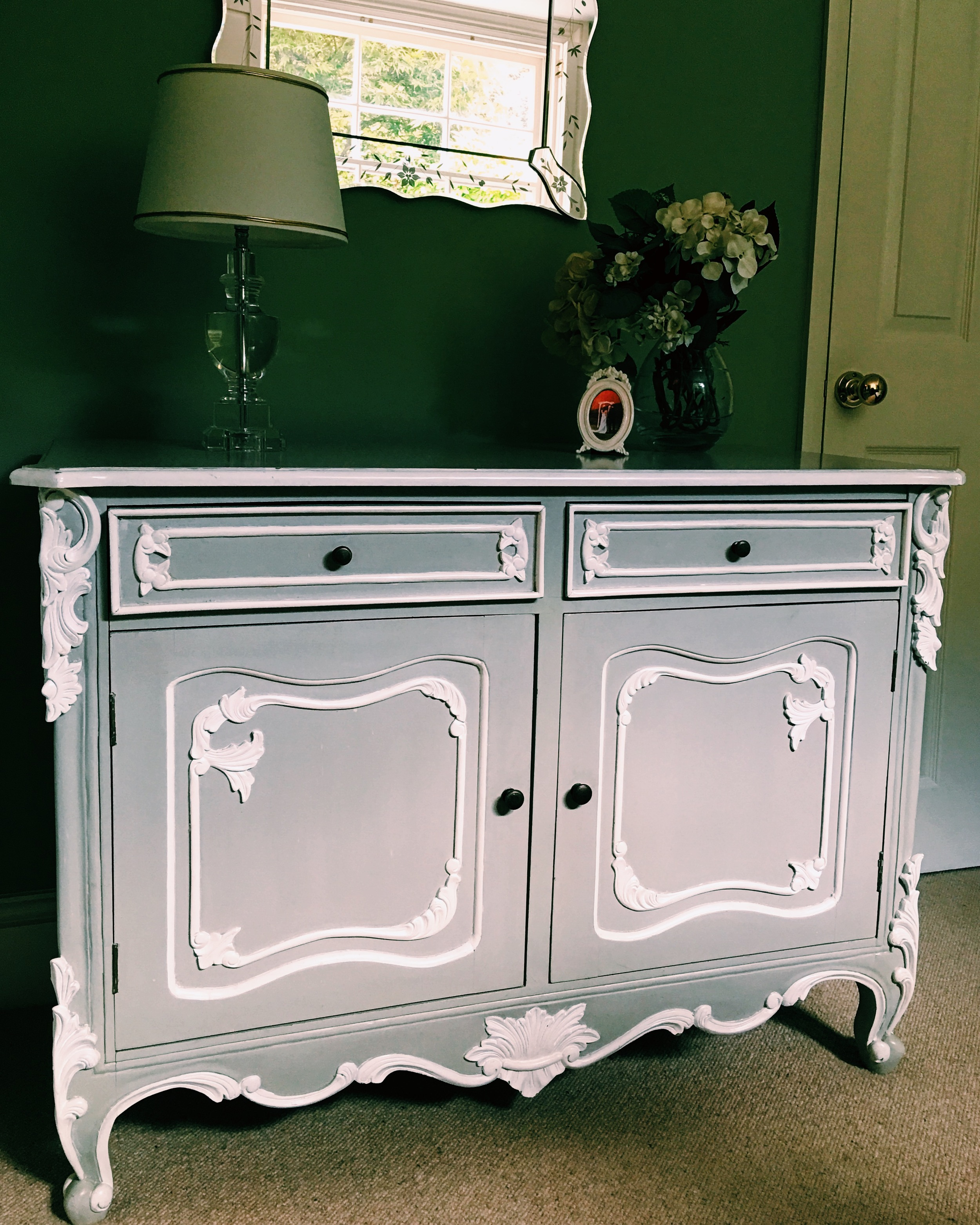 I won this French cabinet that's in our guest room at auction.