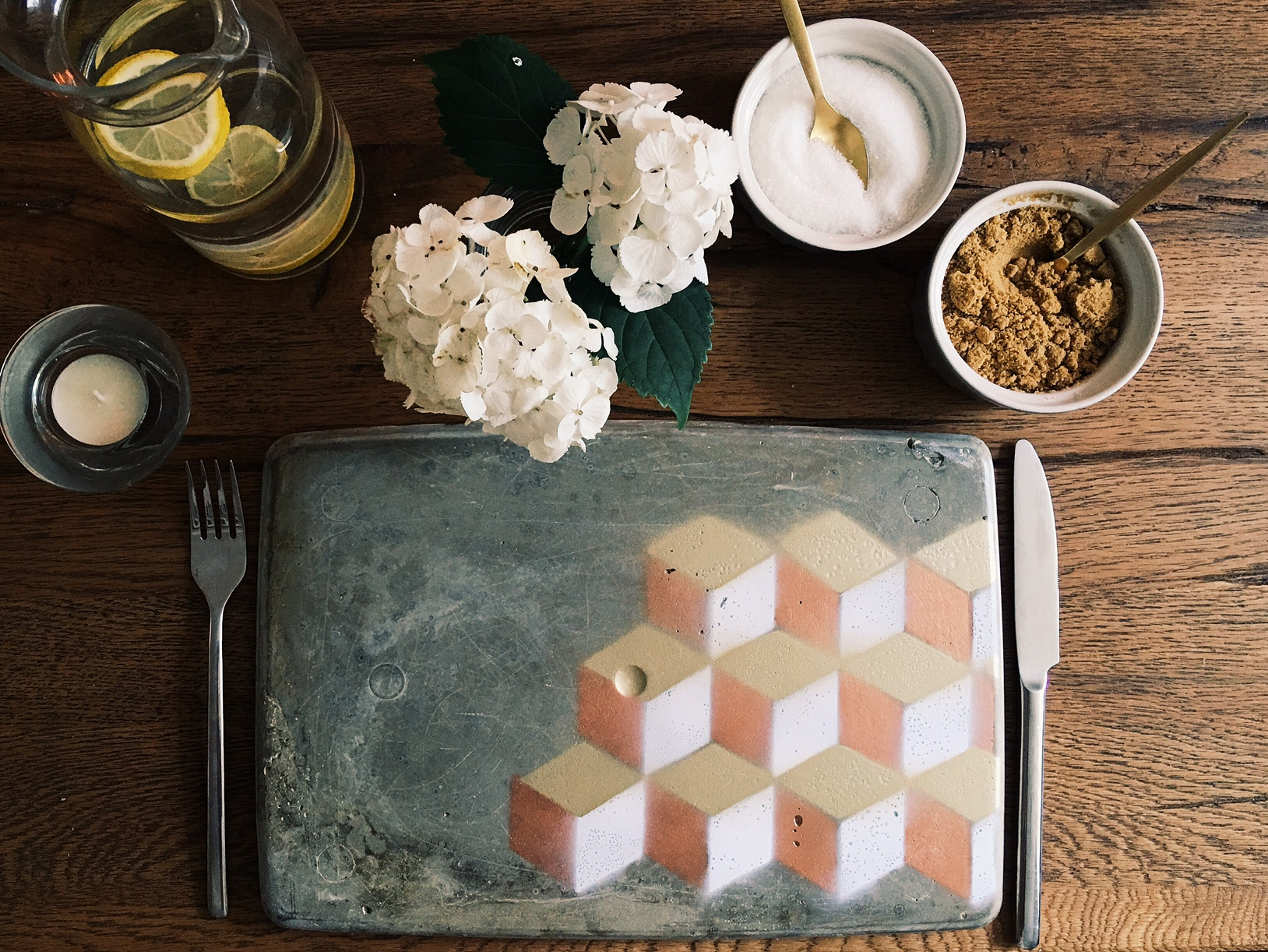 Hand made from start to finish - concrete place mat with spray painted geometric pattern