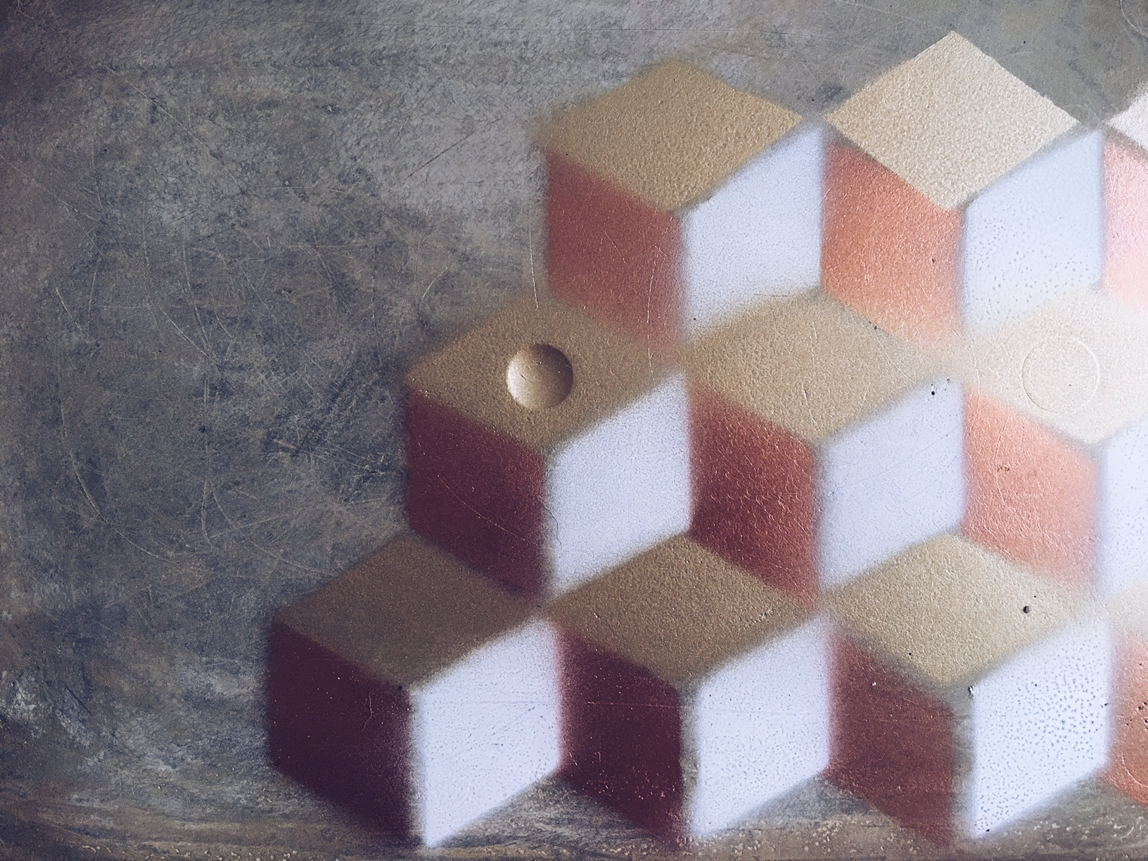 The completed copper, gold and white geometric pattern on one of the mats.