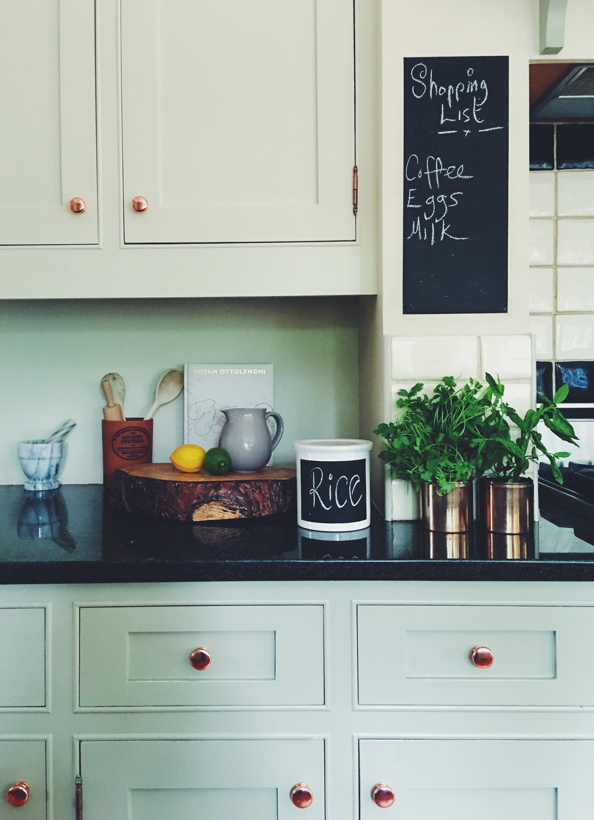 I've used inexpensive chalkboard paint a lot in my kitchen. I've used it to label food pots, and created a shopping list area on an otherwise unused bit of wall.