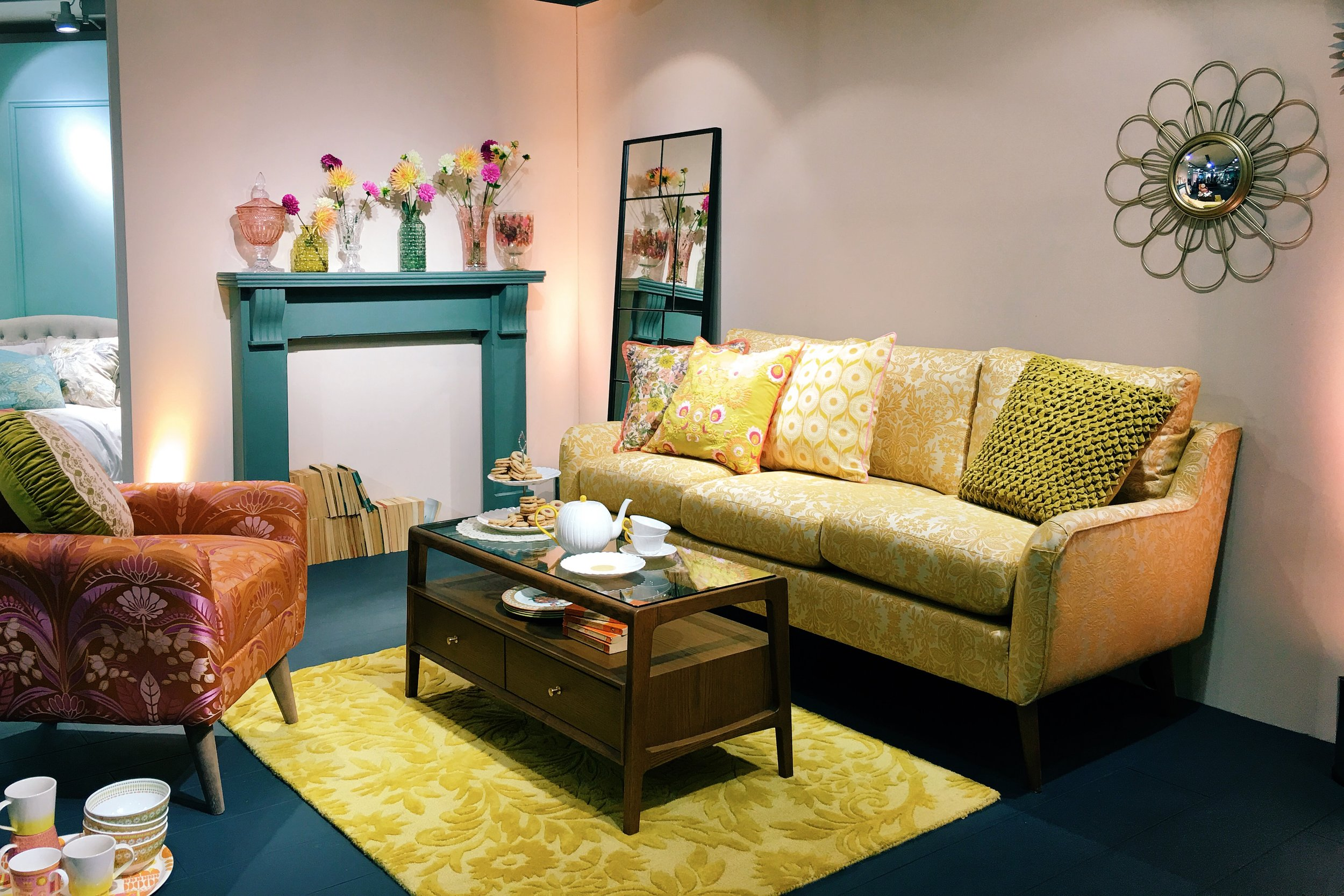 The 70's inspired 'Marigold' collection by M&S. Medium sofa in Meroni Medallion Yellow, £1099. Jolie Chair in Baylie Damask Burnt Orange, £449. Hayward Coffee Table, £349. Sunflower Mirror, £59. Pressed glass vases, from a selection, £12-£25.
