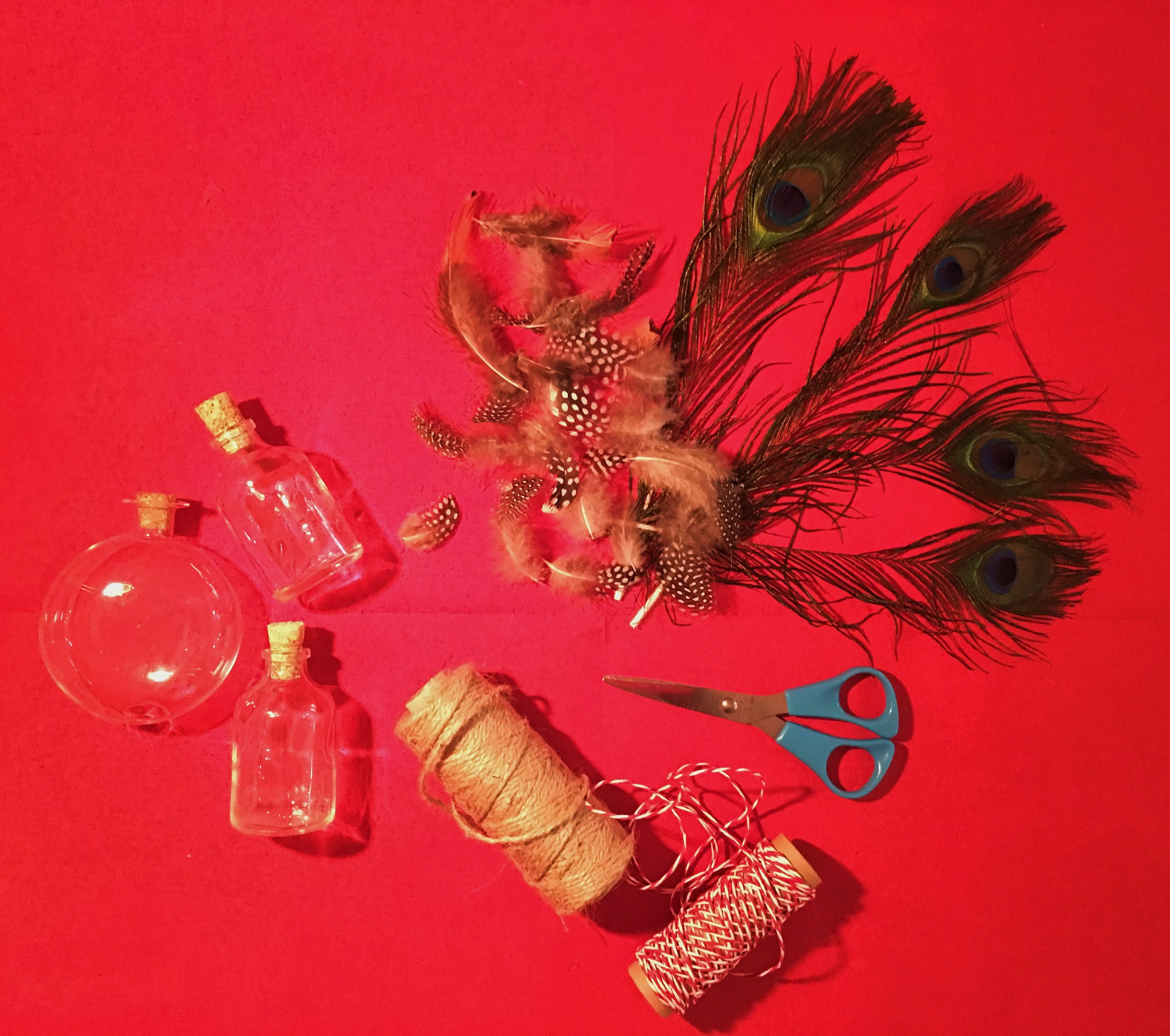 You will need: 50ml glass bottles with cork lids, feathers, scissors, twine/string.