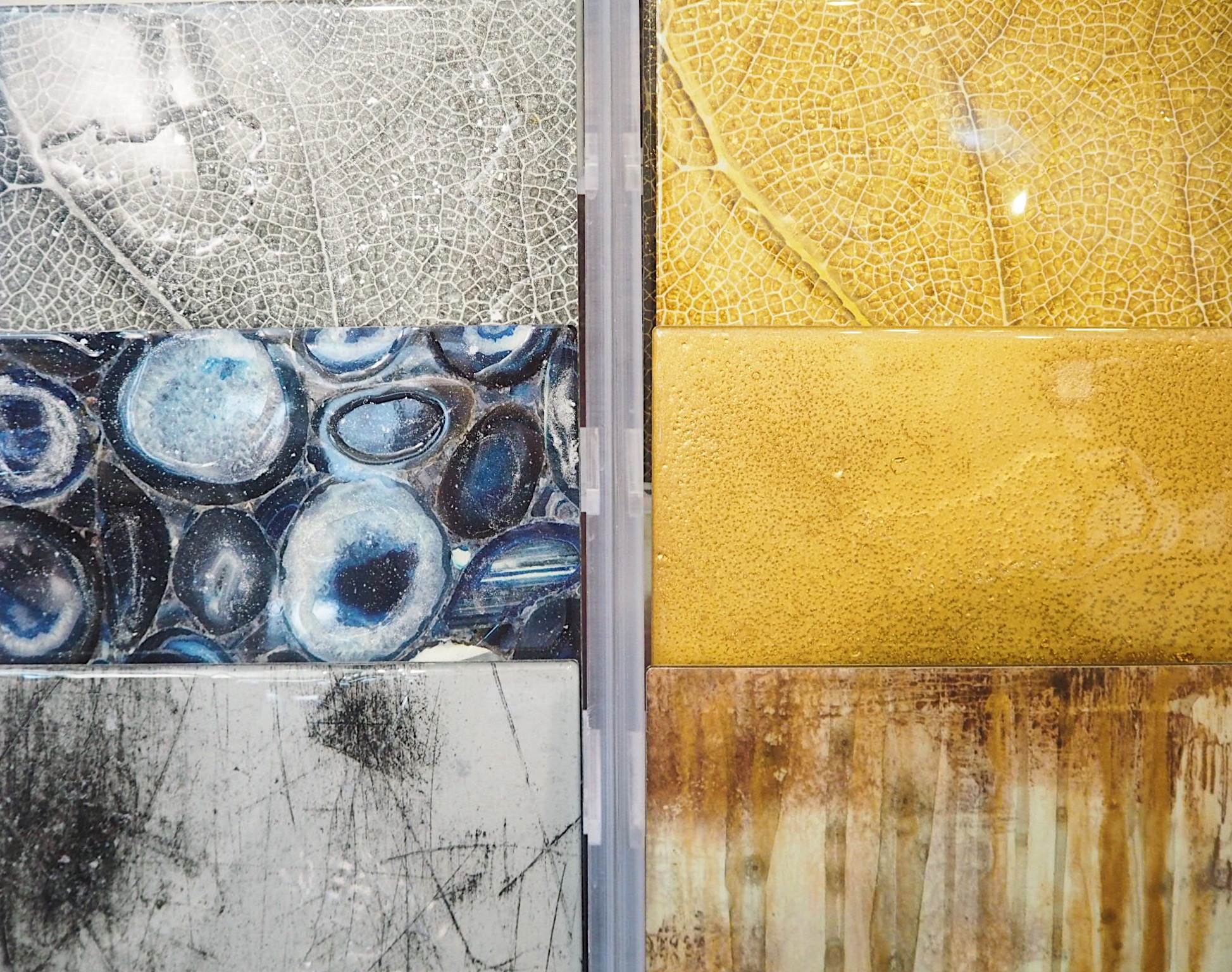 The photographs on the Via Arkadia light box (top), and above, the design of the tiles featured in the showroom.