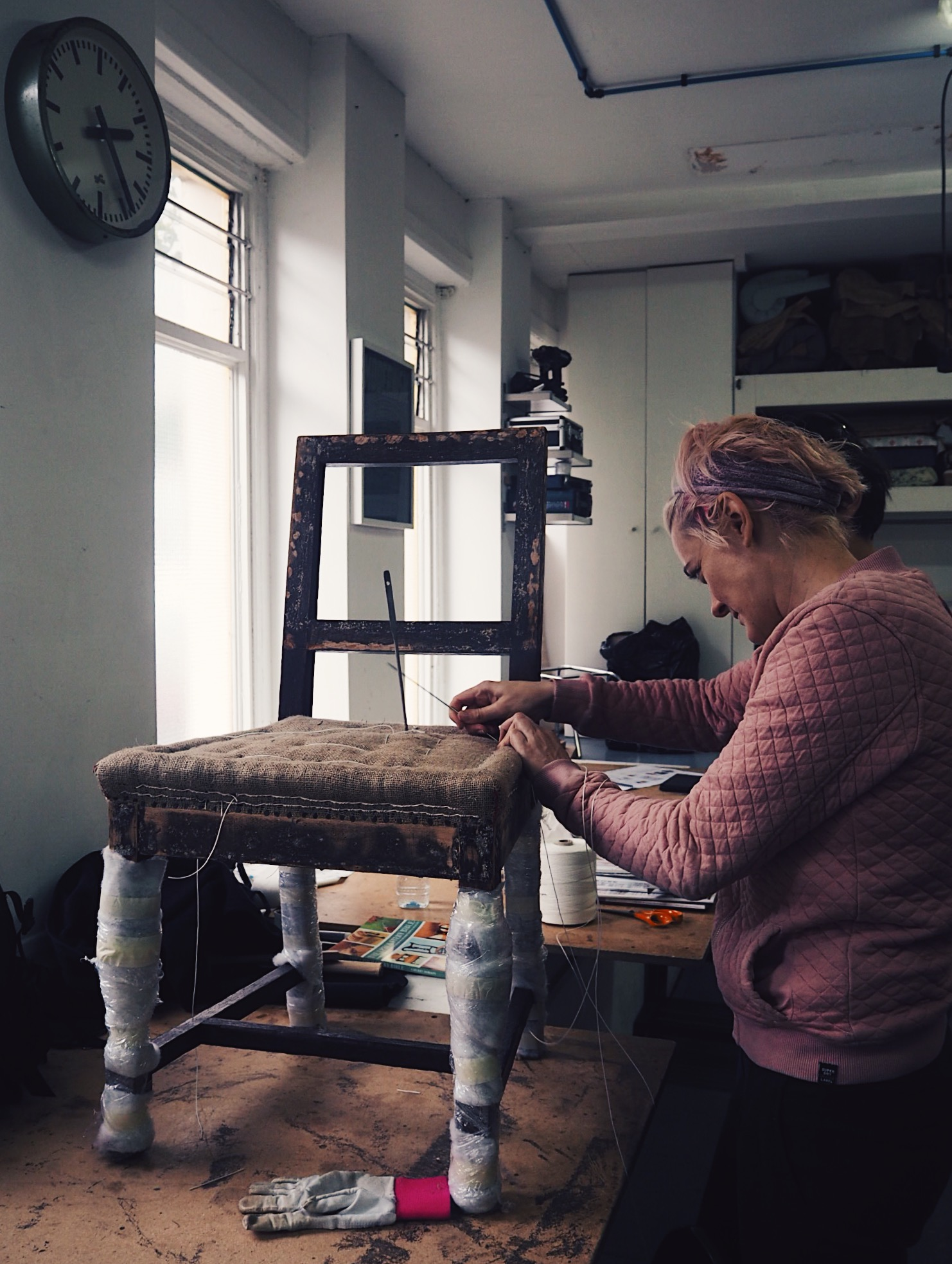 Shoreditch Design Rooms owner and teacher Louise Boyland, demonstrating to a student part of the upholstery process.