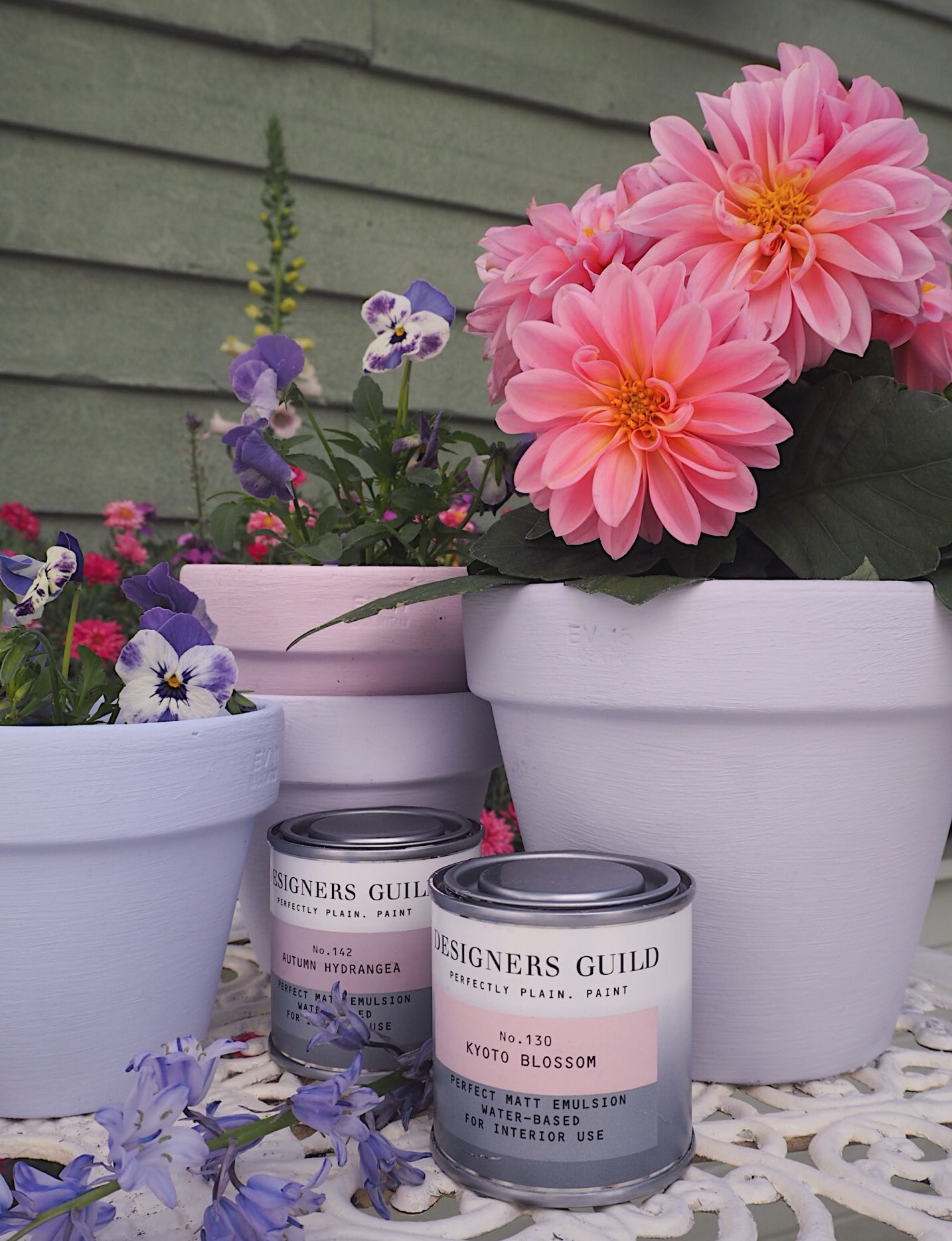 From left to right, pots painted in French Lavender, Faded Blossom, Lilac Bud and First Wisteria, all  Designers Guild.
