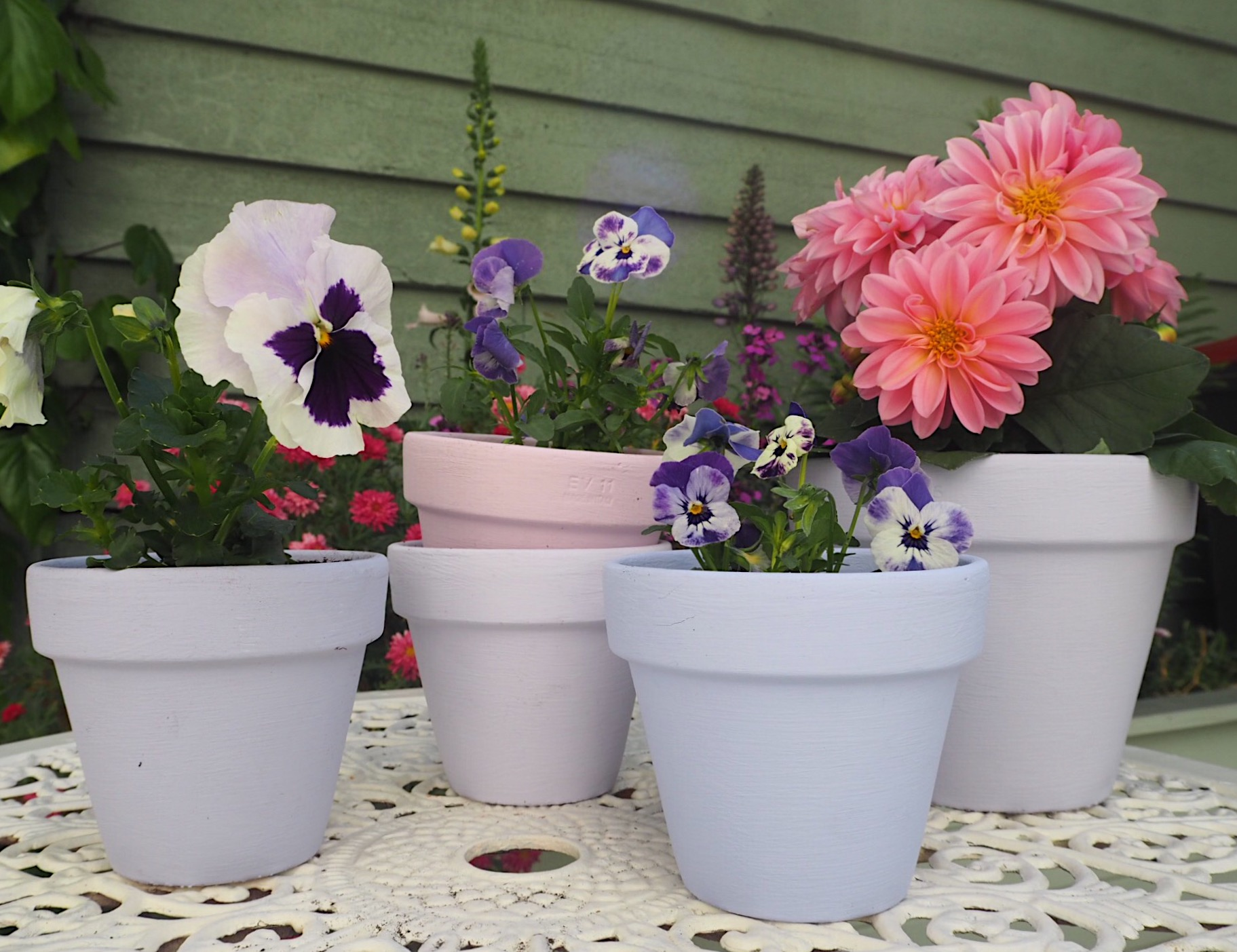 From left to right, Allium, Lilac Bud, Faded Blossom, French Lavender & First Wisteria, all  Designers Guild paint.