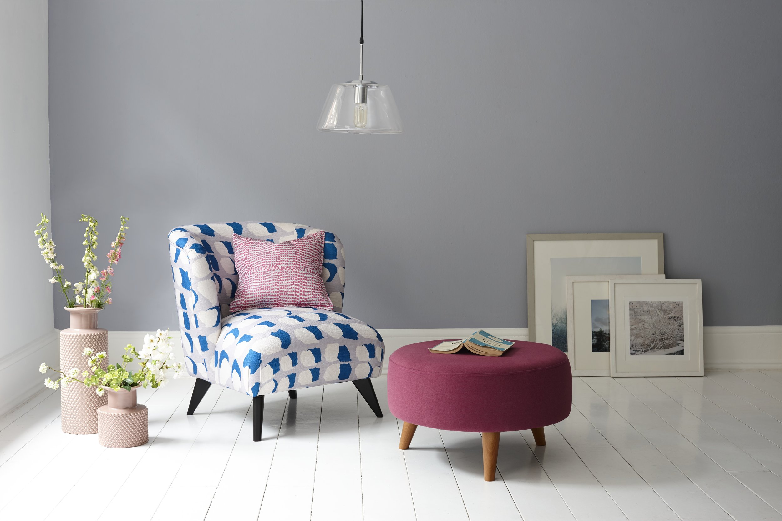 Laze    armchair in a fabric by Alisha Abel, £349.    'Wish'    footstool. Both DFS. Photo: © DFS