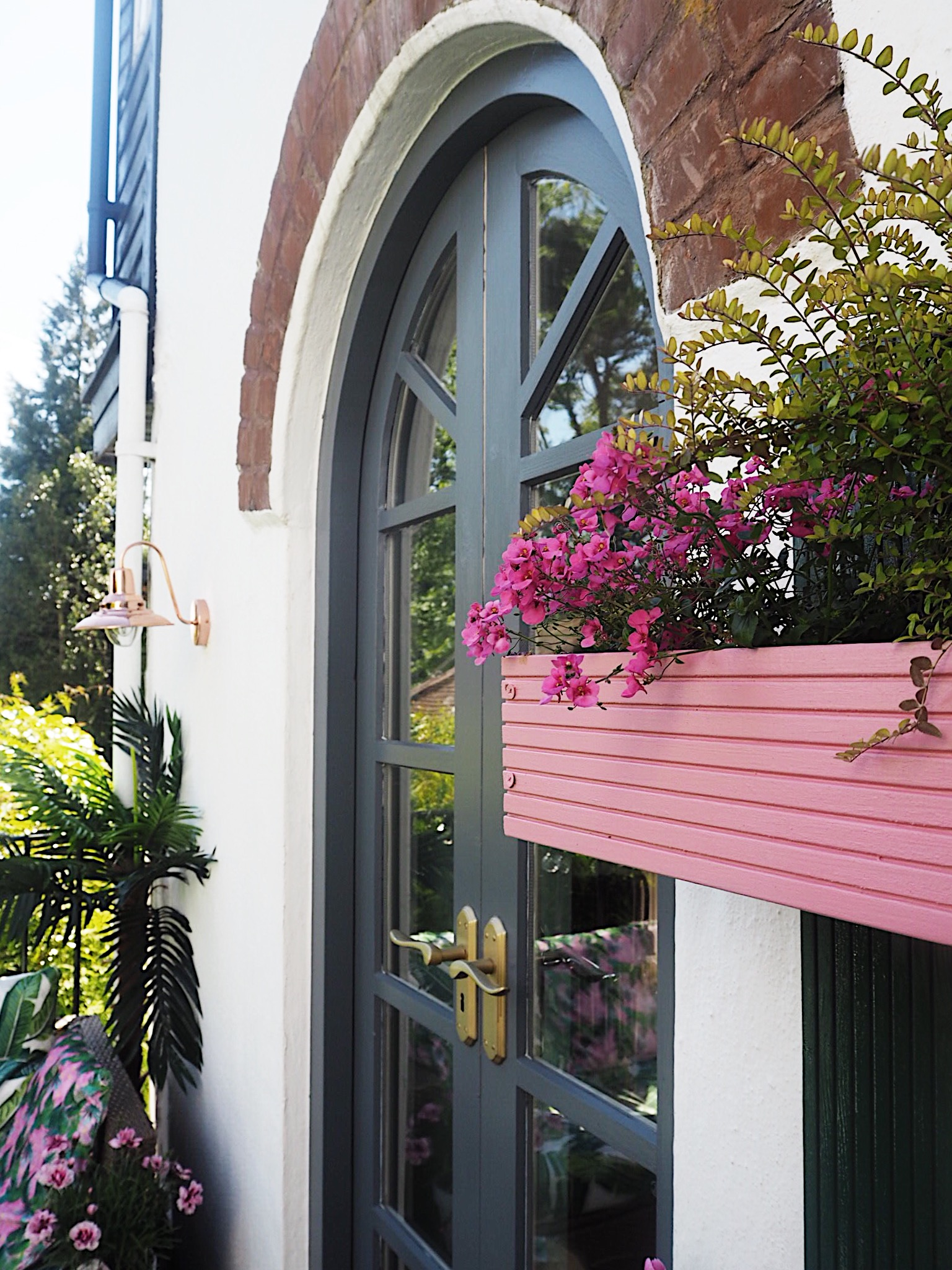This summer I painted planters pink, and gave the balcony doors a fresh coat of exterior paint.